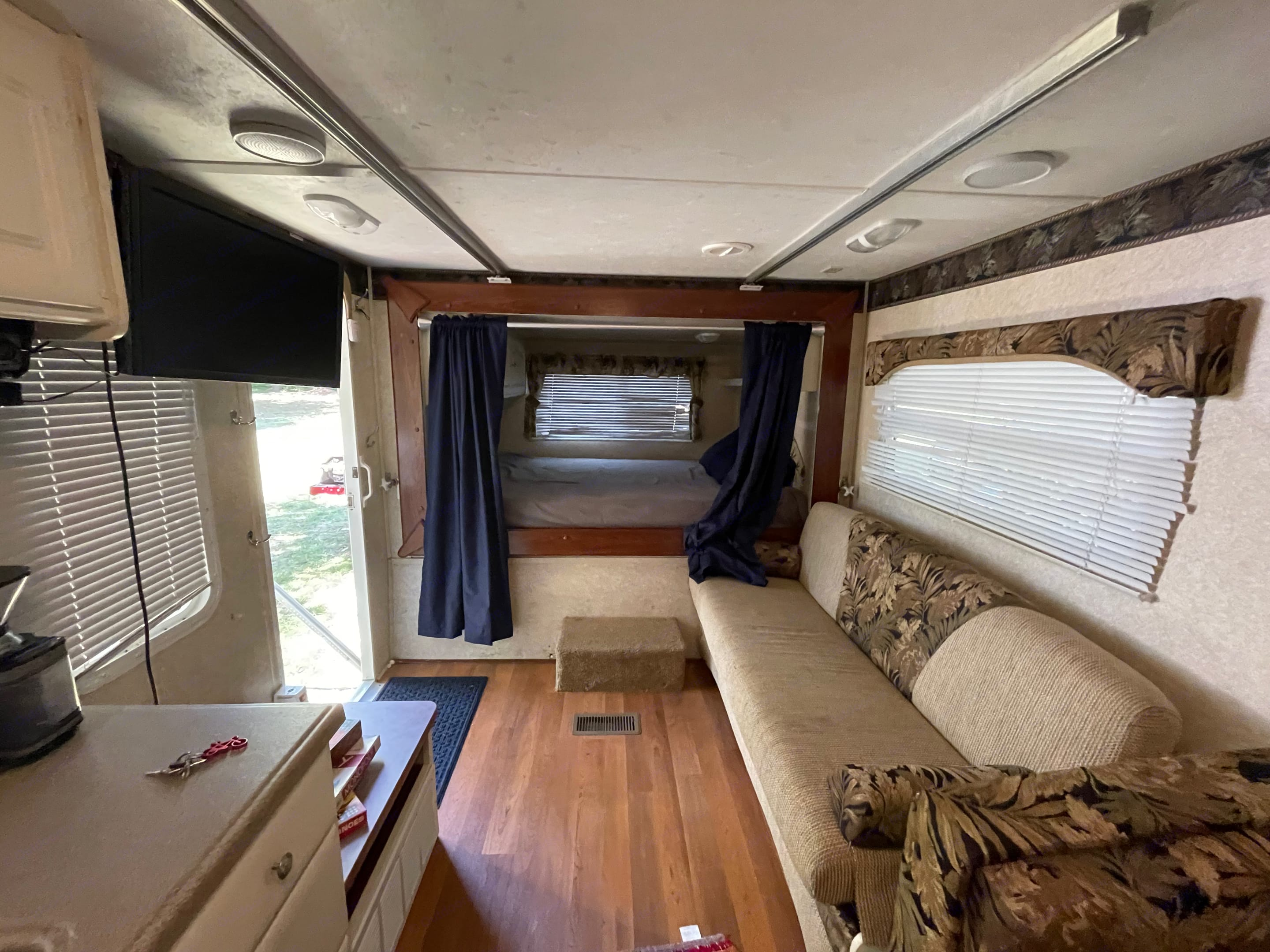 Second queen bed with privacy curtains, a Sofa that folds out into a Full bed, and a swiveling TV!. Keystone Outback 2007