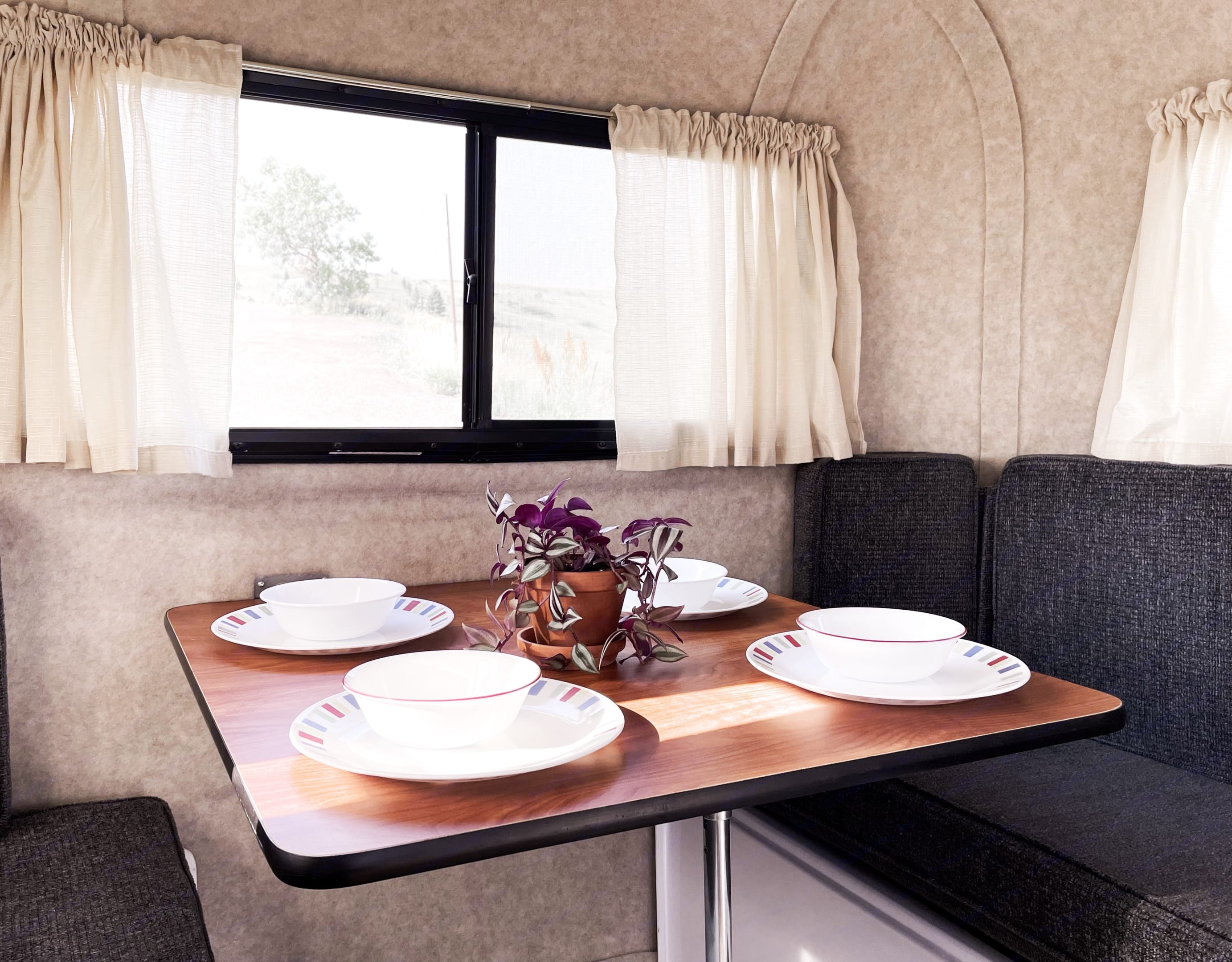 Skyler the 13' Scamp Travel Trailer has room for 4 people to dine comfortably.. Scamp 13' 2018