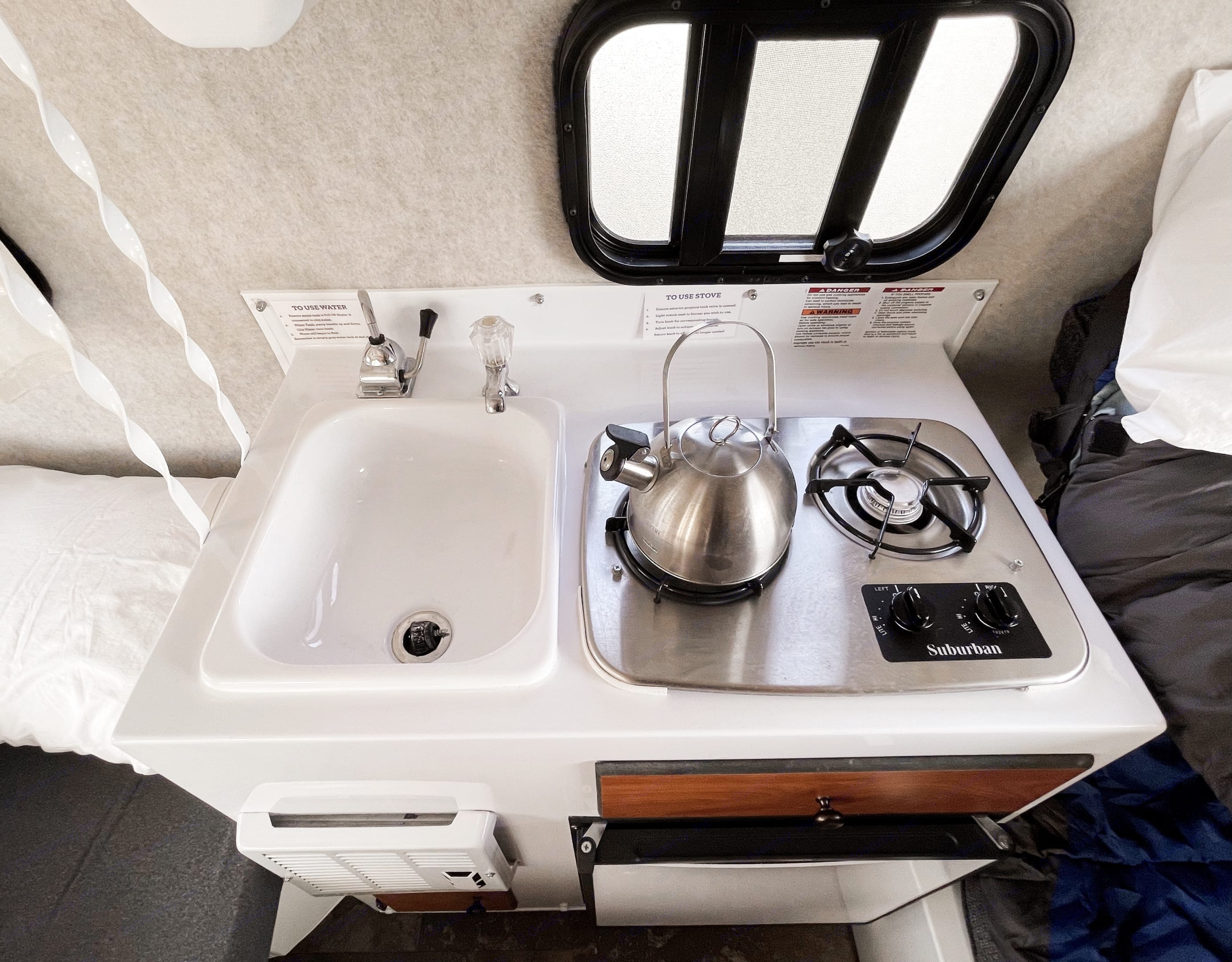 Skyler the 13' Scamp Travel Trailer has a sink, stove and refrigerator.. Scamp 13' 2018