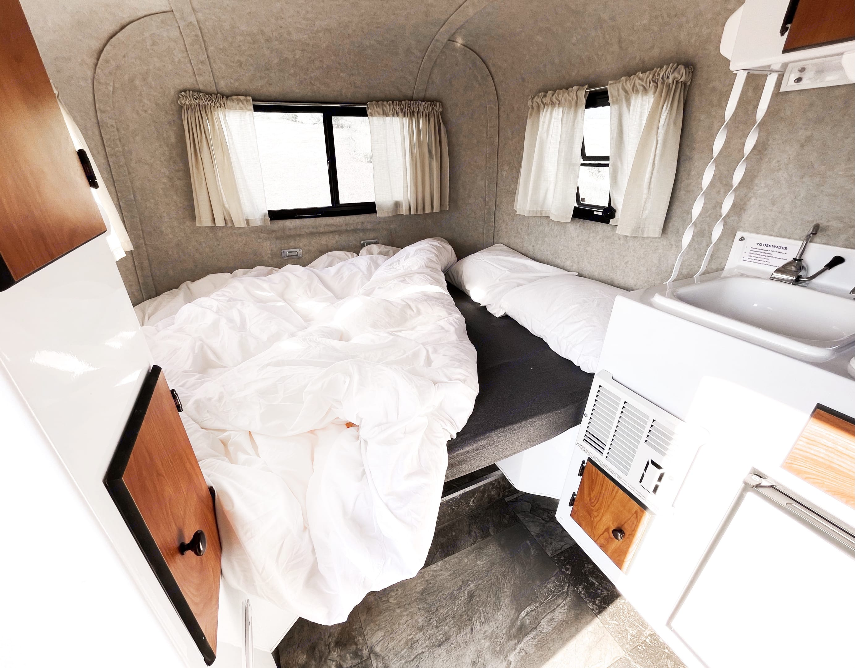 Many hotels aren't as comfy as Skyler the 13' Scamp Travel Trailer. Scamp 13' 2018