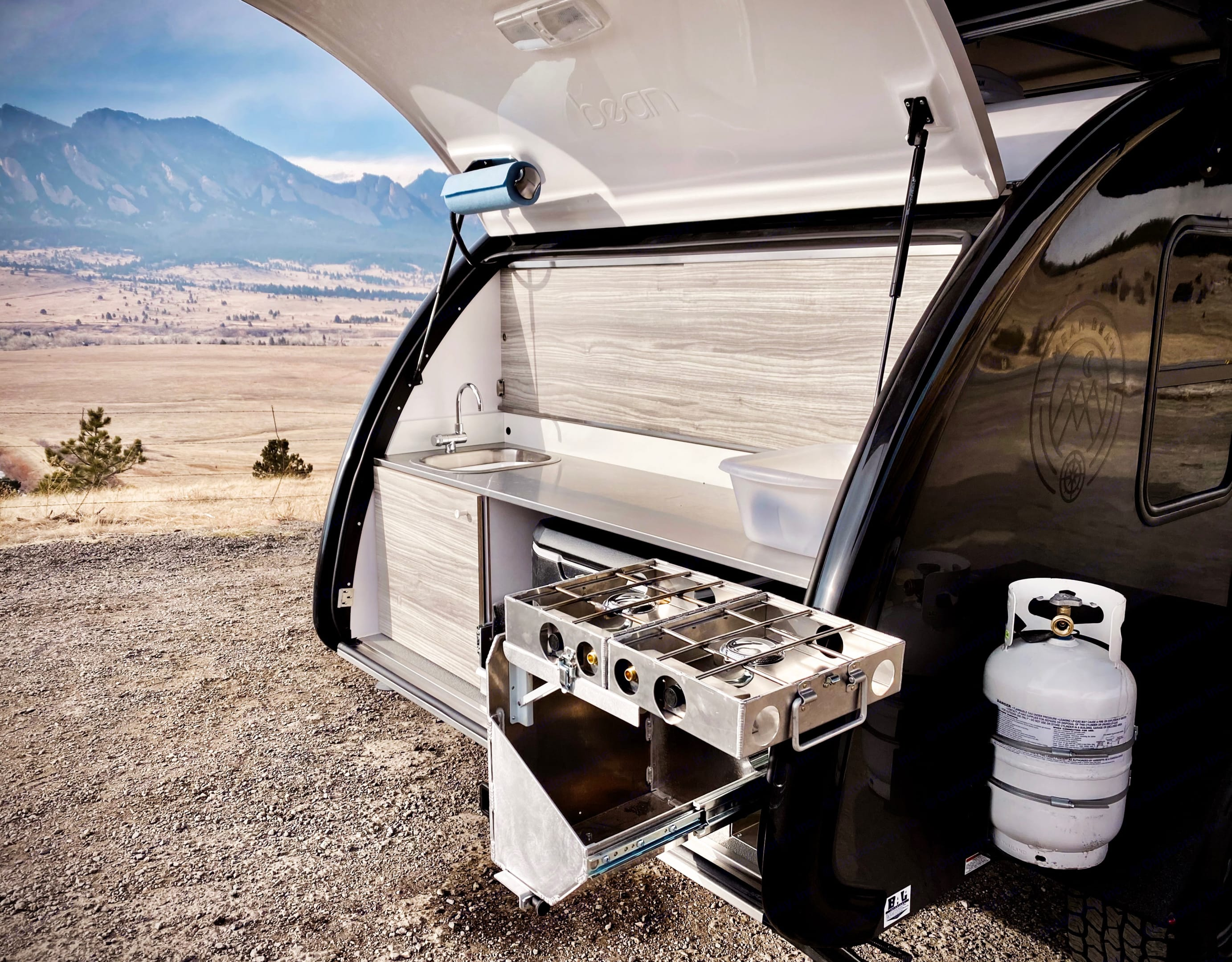 Mobi the Mean Bean Teardrop from Camp Boulder has a durable Camp Partner stove.  It's probably nicer than what's in your own home kitchen!. Bean Teardrop Trailer Mean Bean 2021