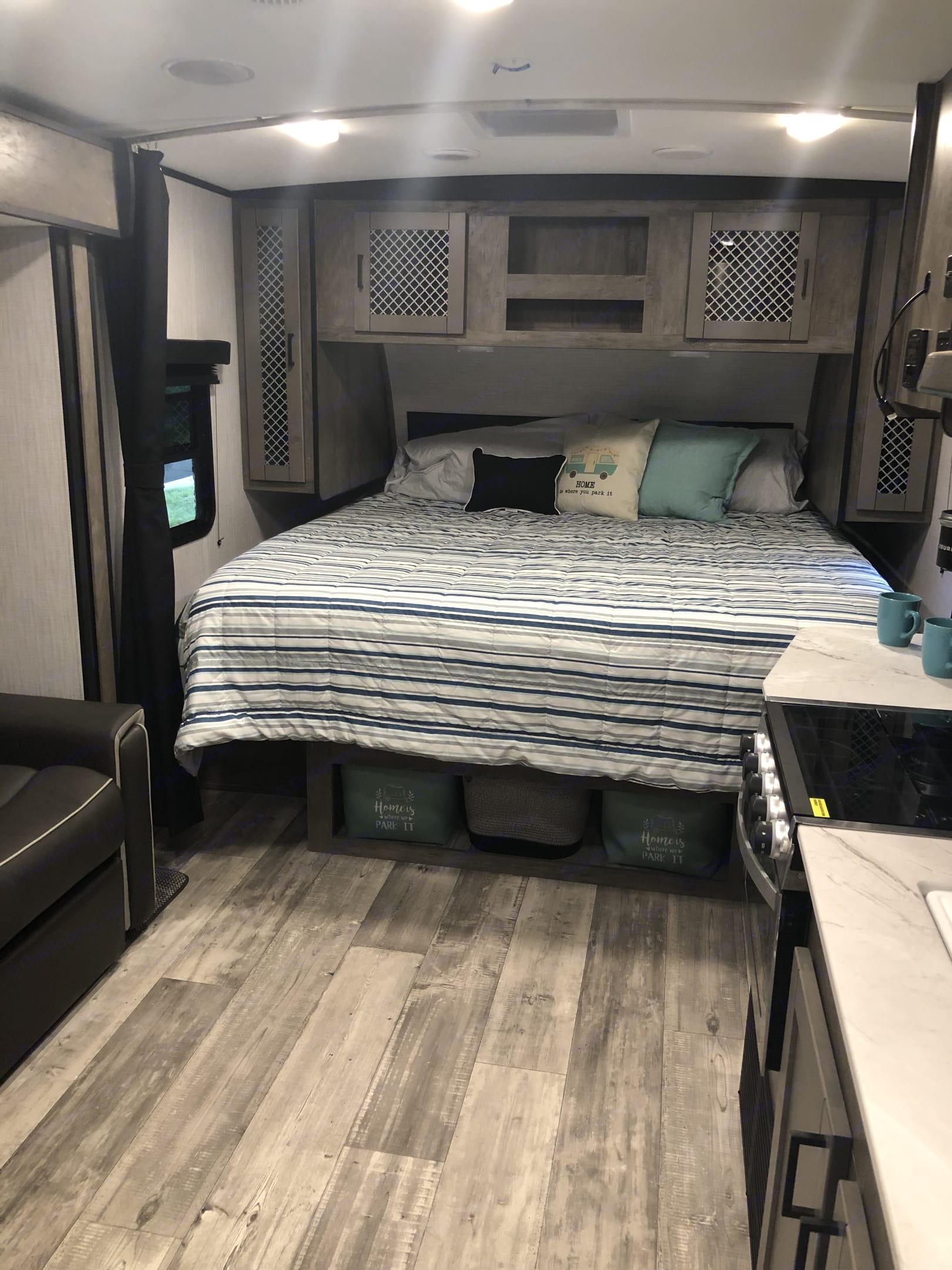Residential king size bed with under bed storage plus basket storage . Heartland North Trail 2021