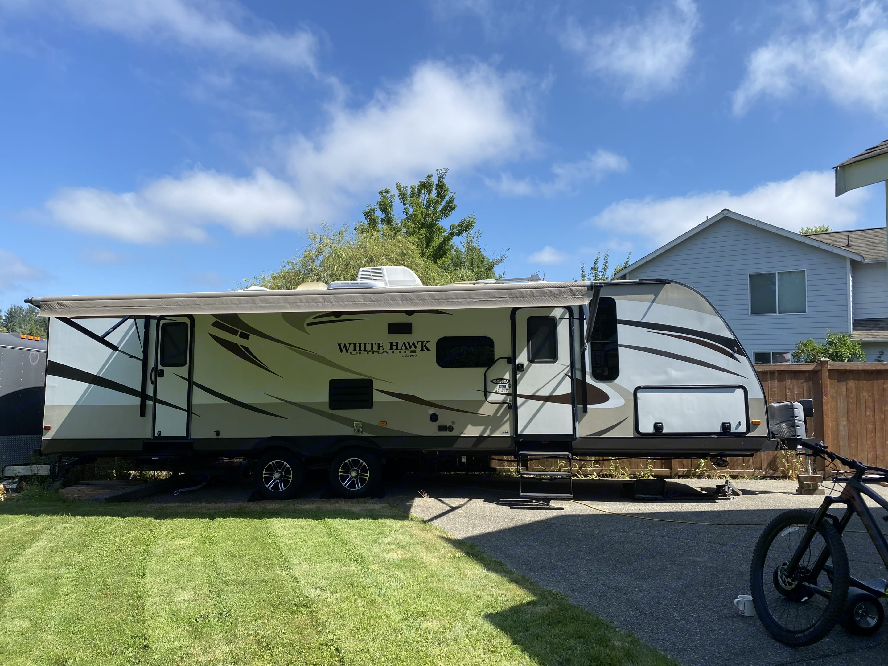 Beautifully maintained front of trailer with awning out. Has LED lights for night time.. Jayco White Hawk Ultra Lite 2015