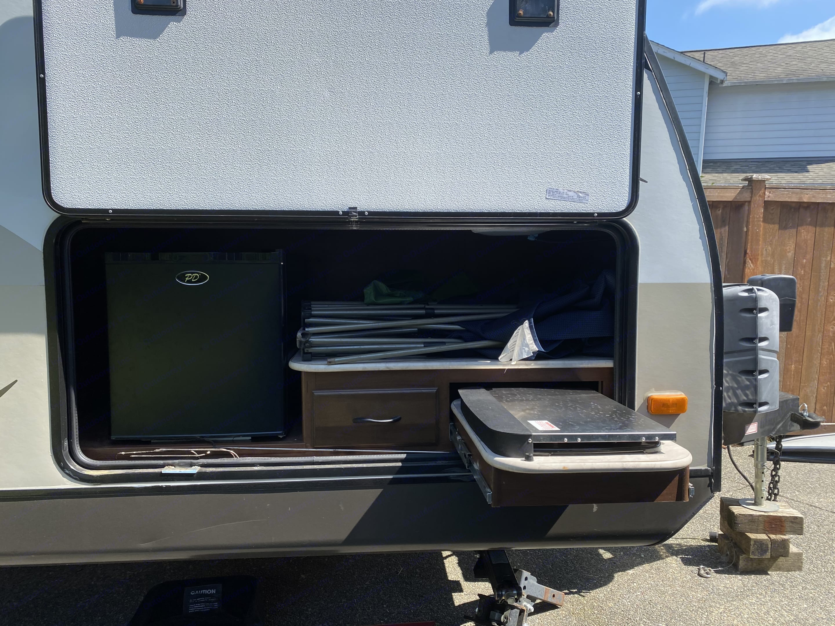 This is your outdoor kitchen with fridge/cooktop/and storage. . Jayco White Hawk Ultra Lite 2015
