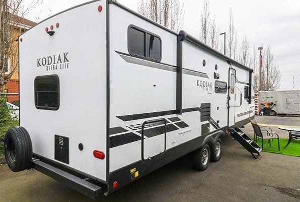 34 total feet with large power awning, outdoor fridge and attached outdoor propane grill.   . Dutchmen Kodiak 2021