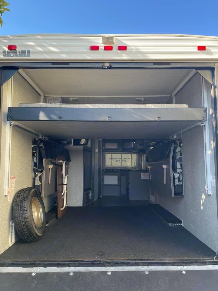 Electric drop down queen bed, 2 fold up couches that convert to sleeping areas. . Skyline Nomad 2008