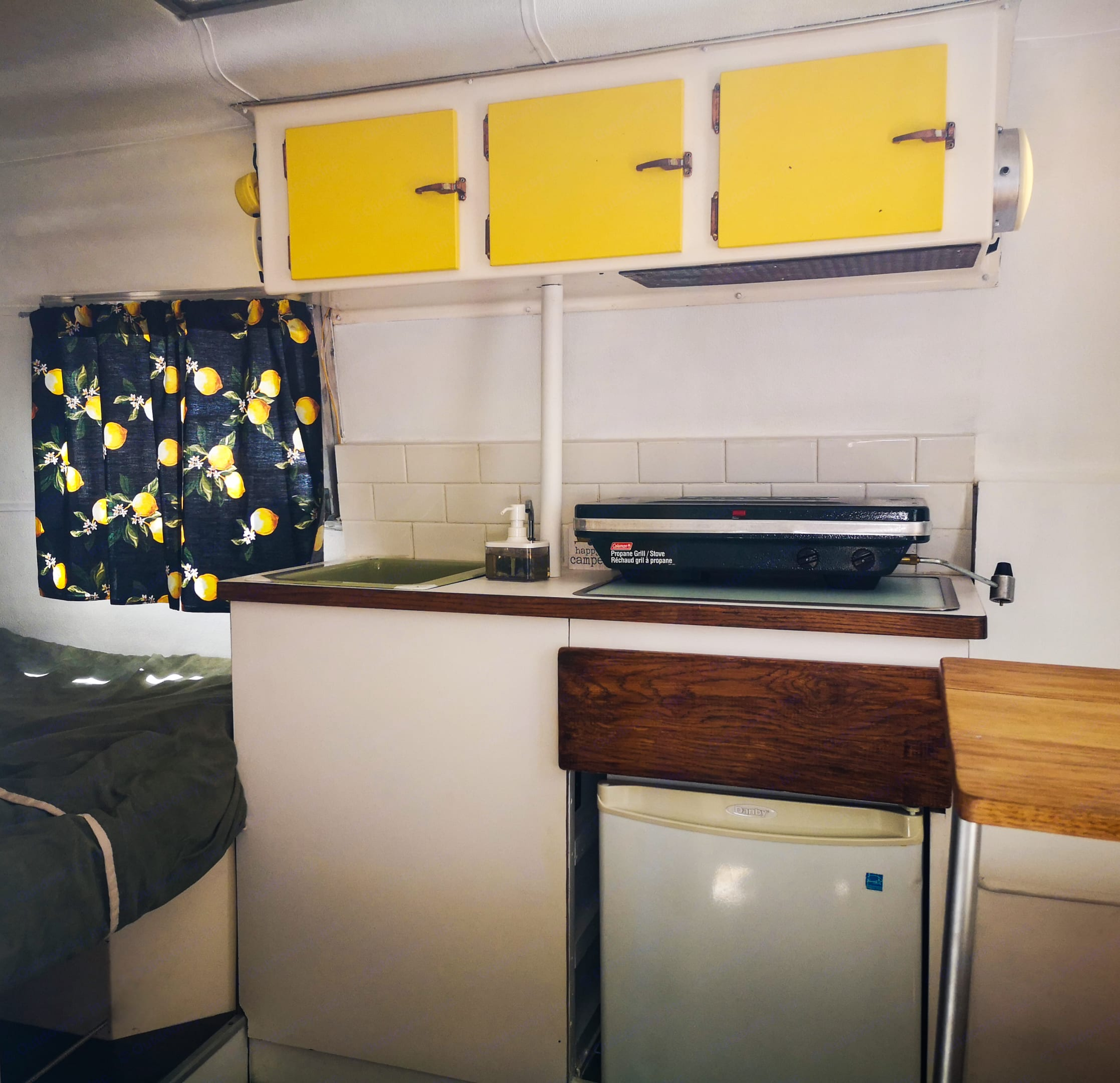 Potable water and pump faucet, small fridge (requires camper to be plugged in) and portable propane cooker that can be removed for extra counter space. Other Other 1974