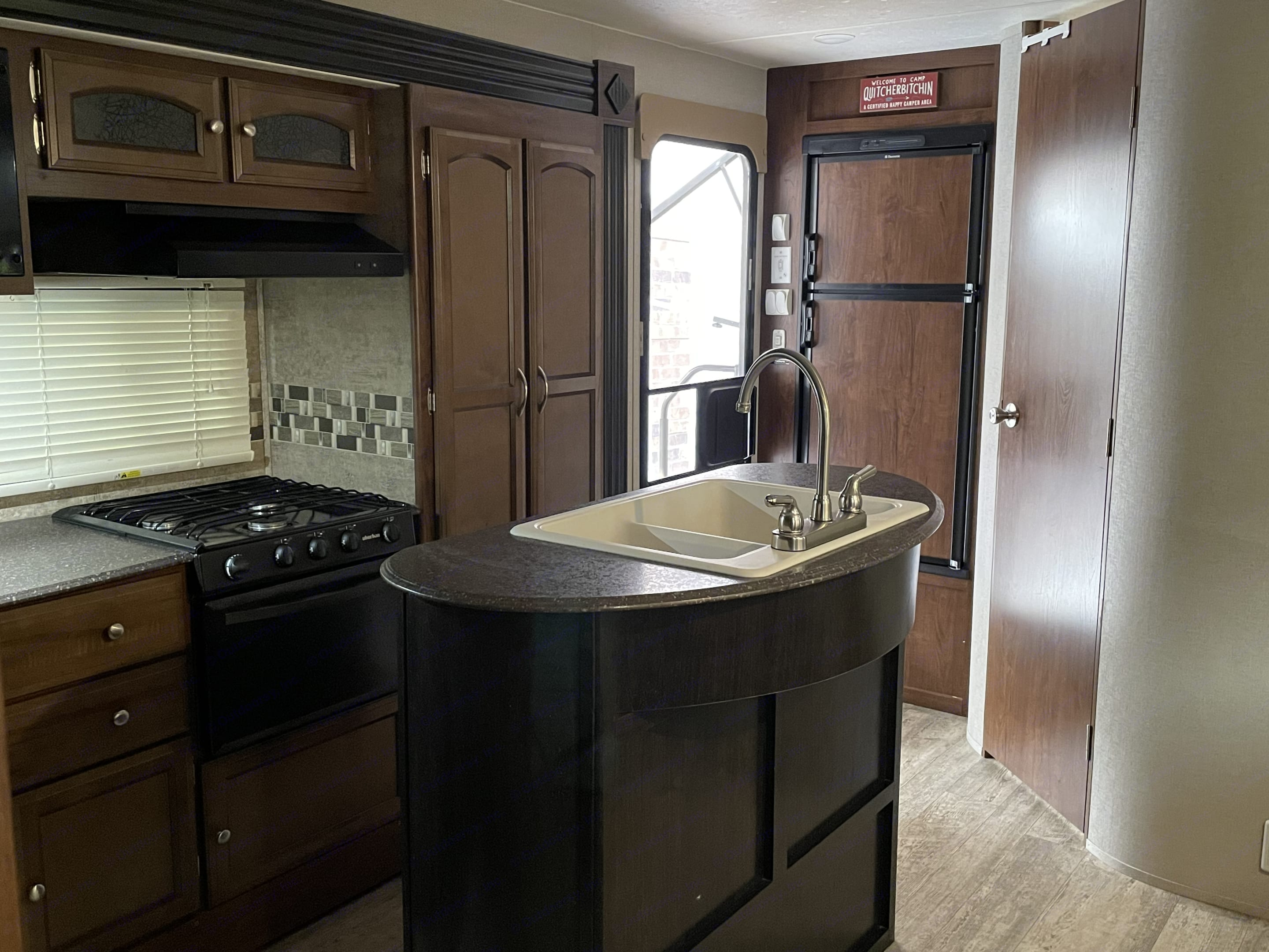 The island is not only chic, but has additional plugs, which is a good place to put the included coffee maker, or anything else that may need power. . Coachmen Freedom Express 2017