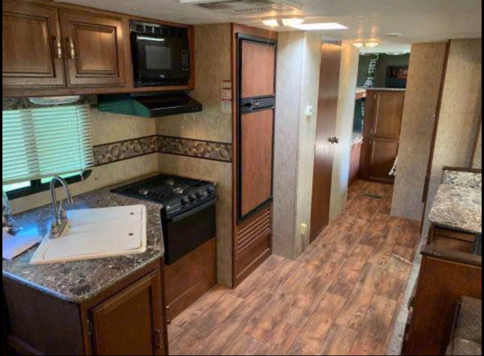 Kitchen, dining, bathroom and bunk area. Keystone Passport 2016