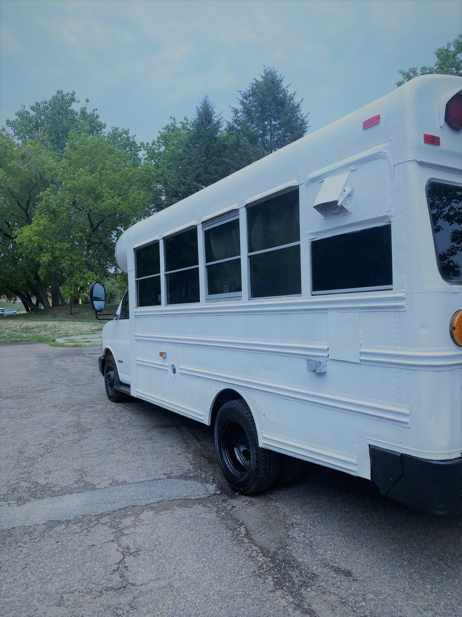 Main 110v electrical hookup and the exterior AC vent and drain. . Blue Bird Bus 2006