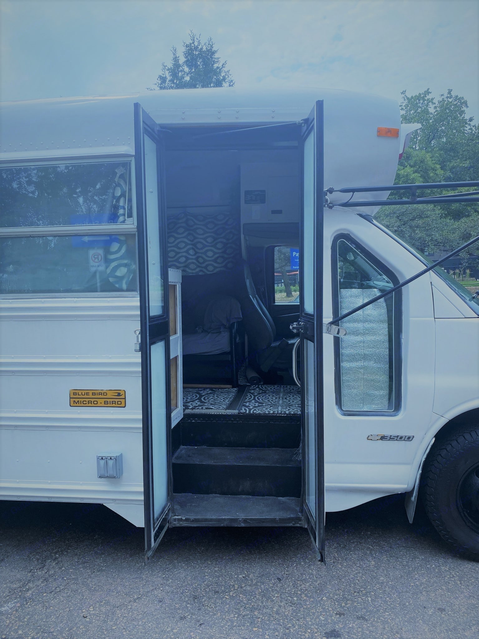 Keeping the original school bus doors gives this camper a look that brings you back to your childhood. . Blue Bird Bus 2006