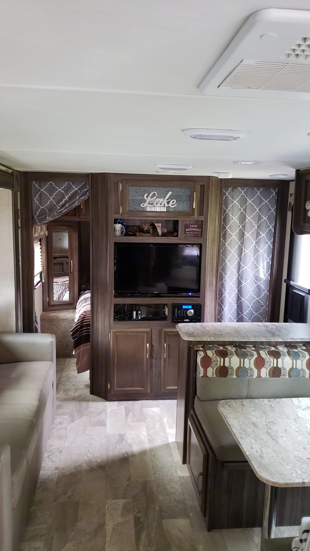 Master bedroom with TV wall. . Coachmen Apex 2017