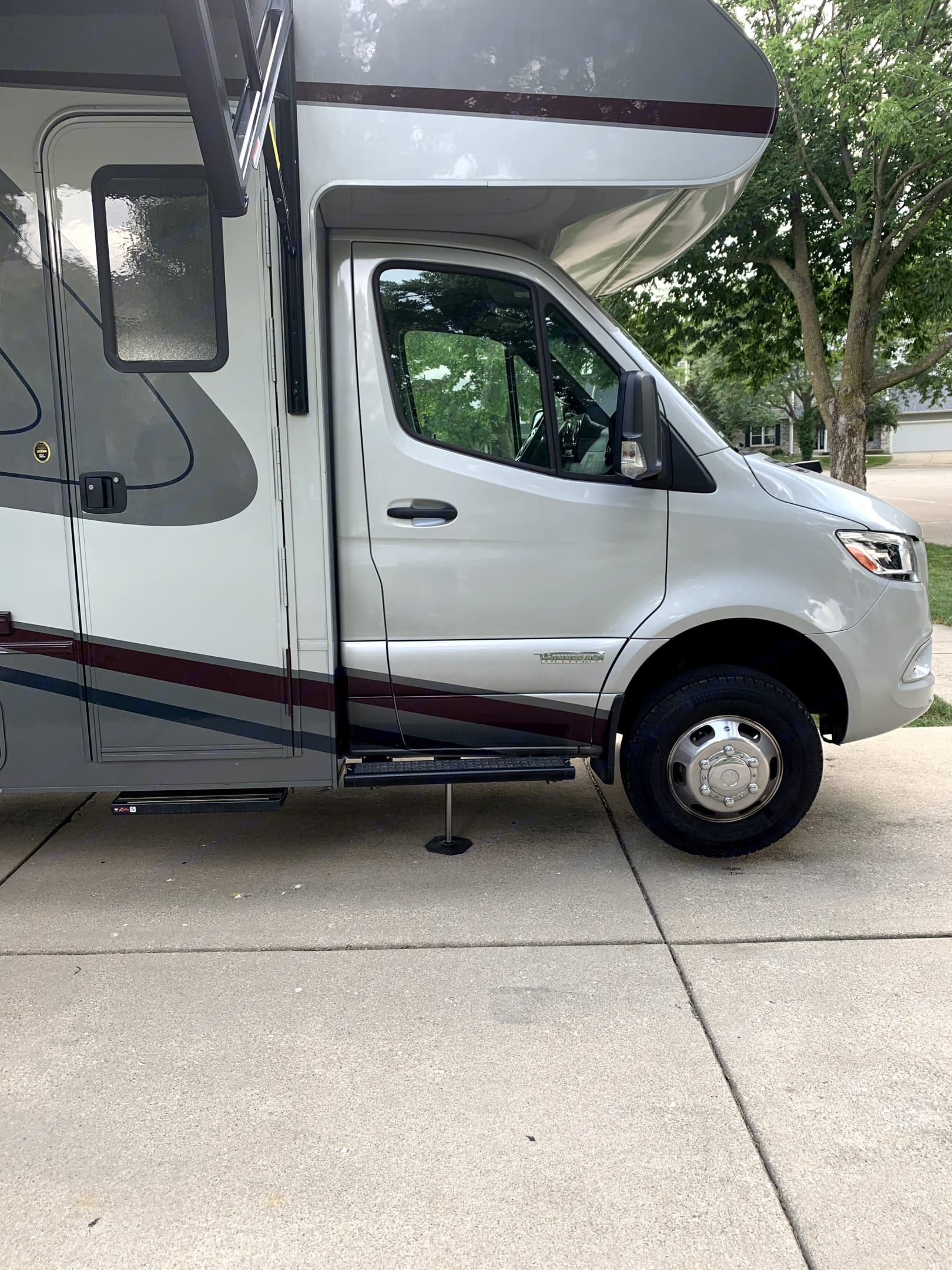 Parked and leveled - Passenger side. Winnebago View 2022