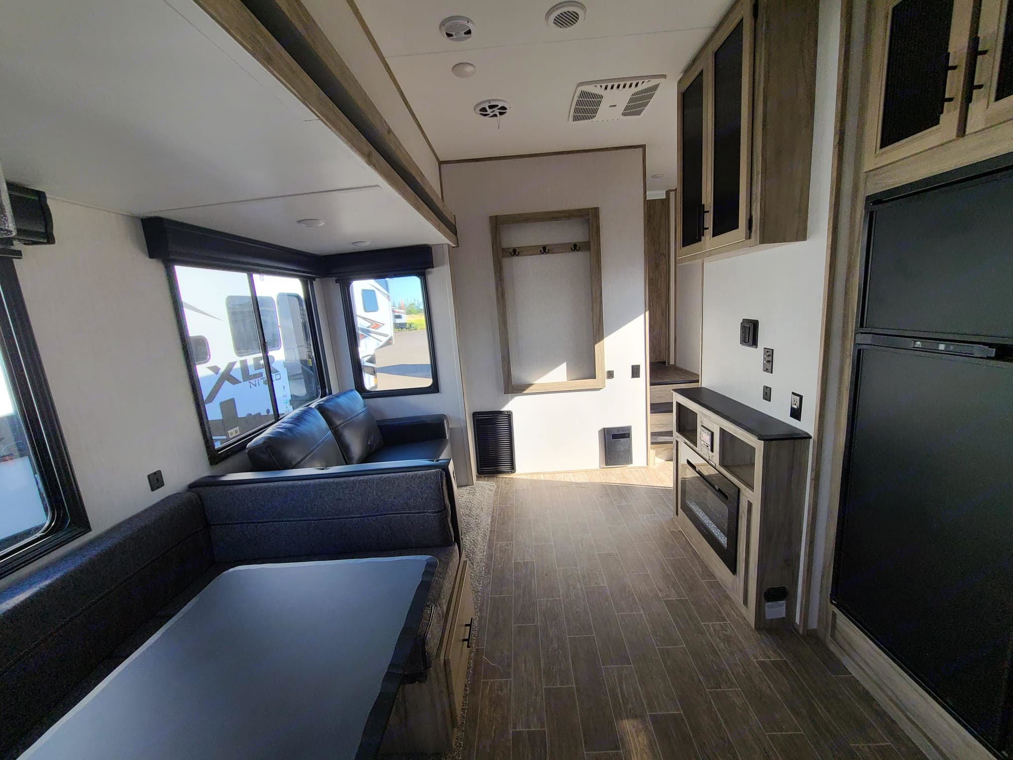Dinette that converts to a bed, Couch with pullout bed, Electric Fireplace with TV Hookup, Stereo with bluetooth capability and zone control. Forest River Cherokee 2021