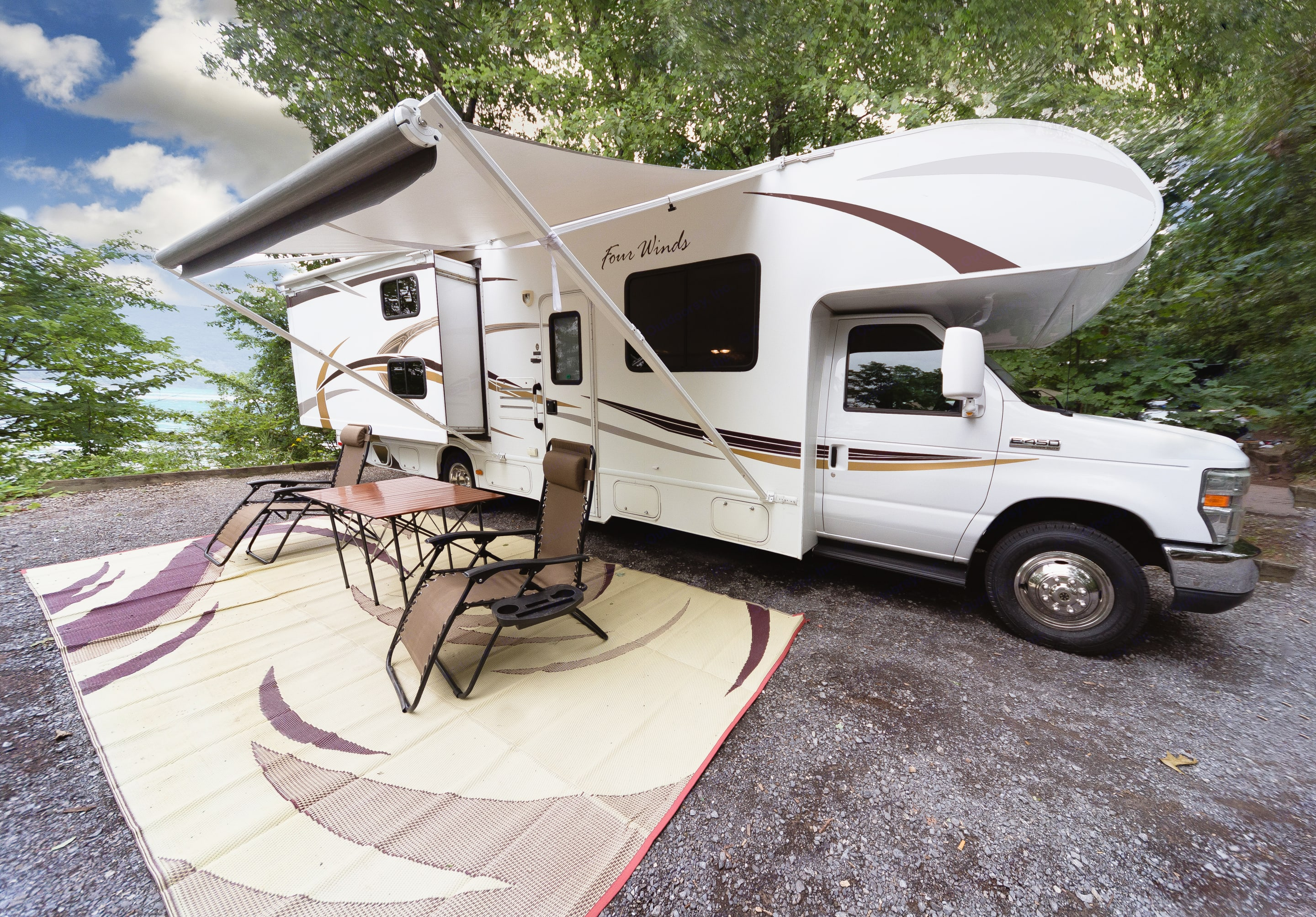 RV comes with two zero gravity folding chairs and one folding teak colored table and one folding teak colored table and an 18'x8' mat standard.. Thor Motor Coach Four Winds 2013