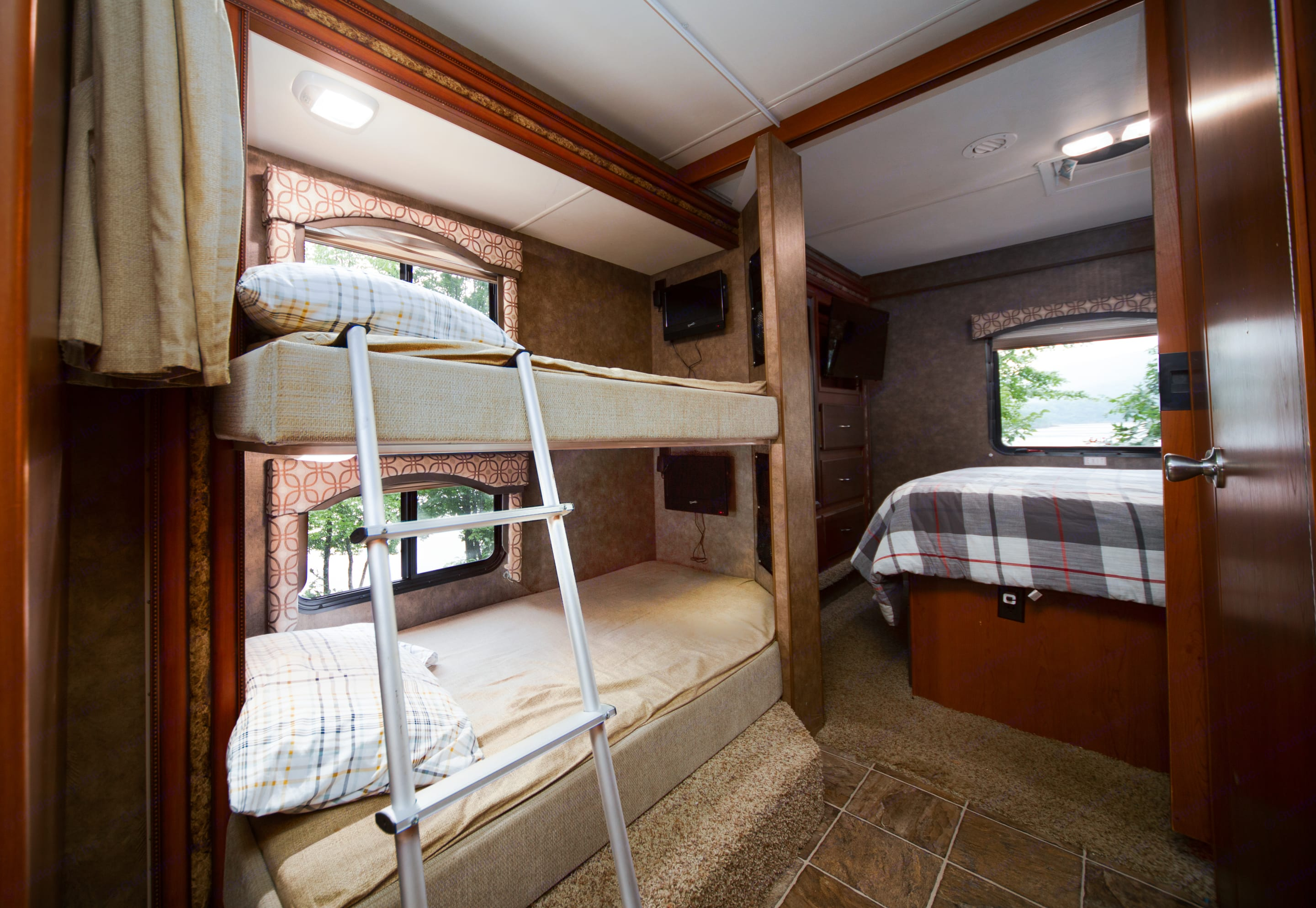 Twin sized bunk beds. Each bunk has it's own TV with built in DVD players and privacy curtain.. Thor Motor Coach Four Winds 2013