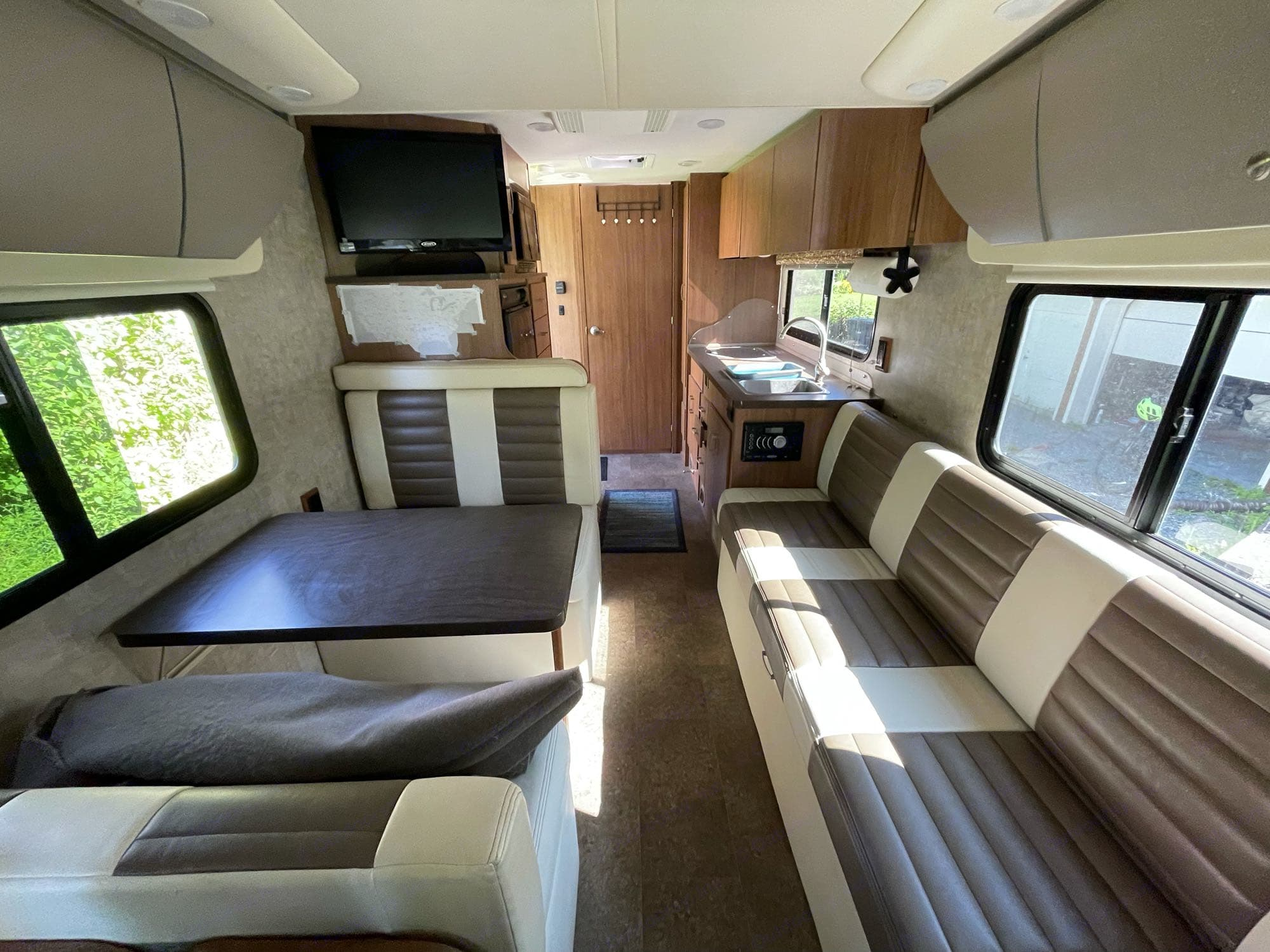 View from the cab, looking toward the back. Very good condition inside and out, super clean, well maintained. . Winnebago Trend 2015