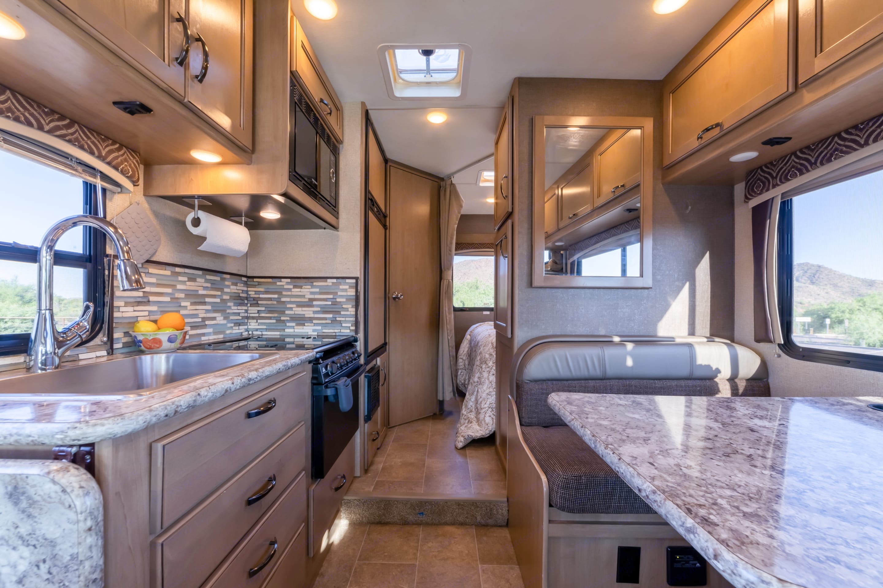 Layout makes sense for entertaining with separate sleeping/bathroom areas.. Thor Motor Coach Chateau 2018