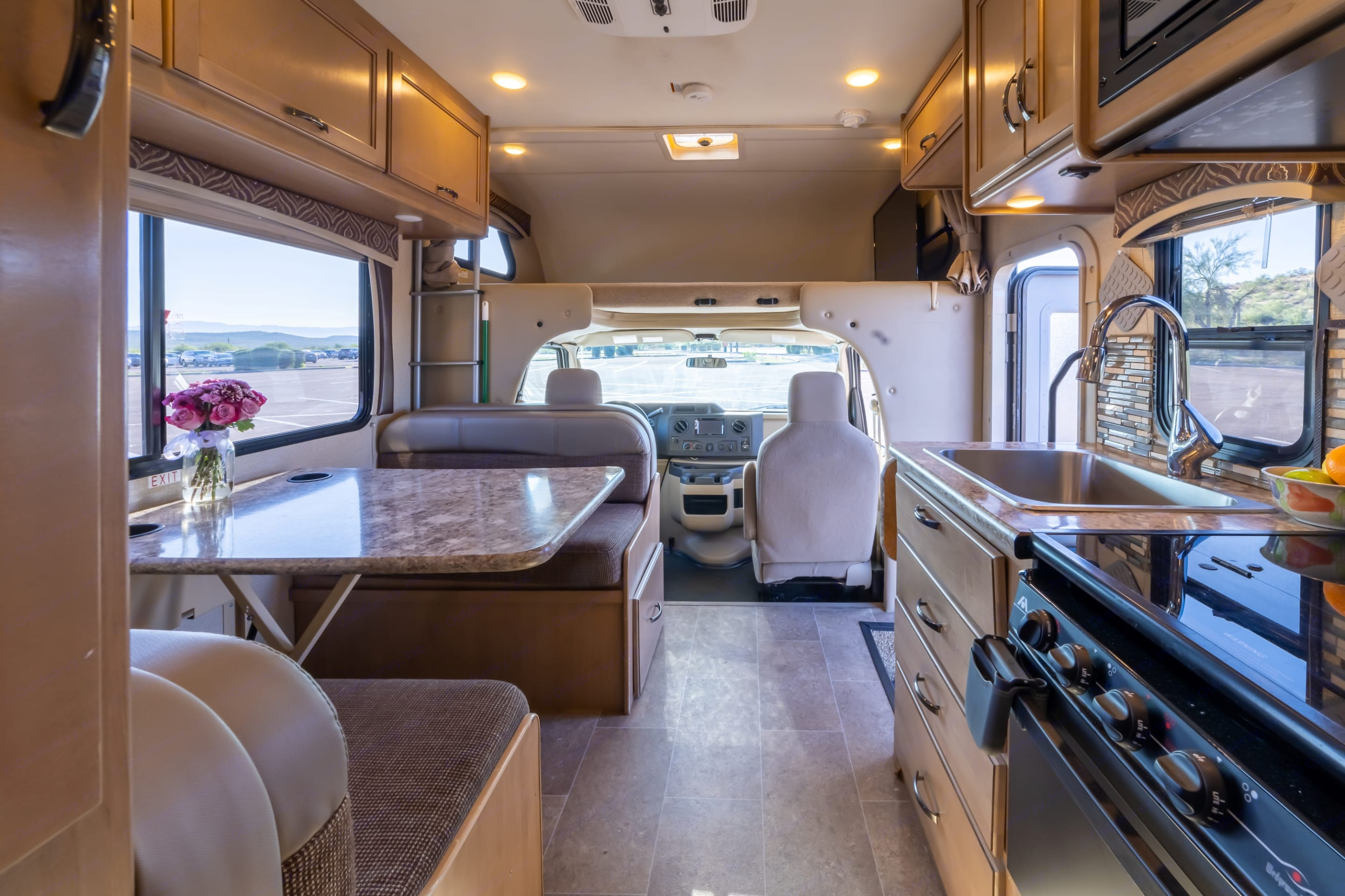 Comfortable interior gives campers all they need to cook, do dishes, entertain, and sleep a crew.  . Thor Motor Coach Chateau 2018