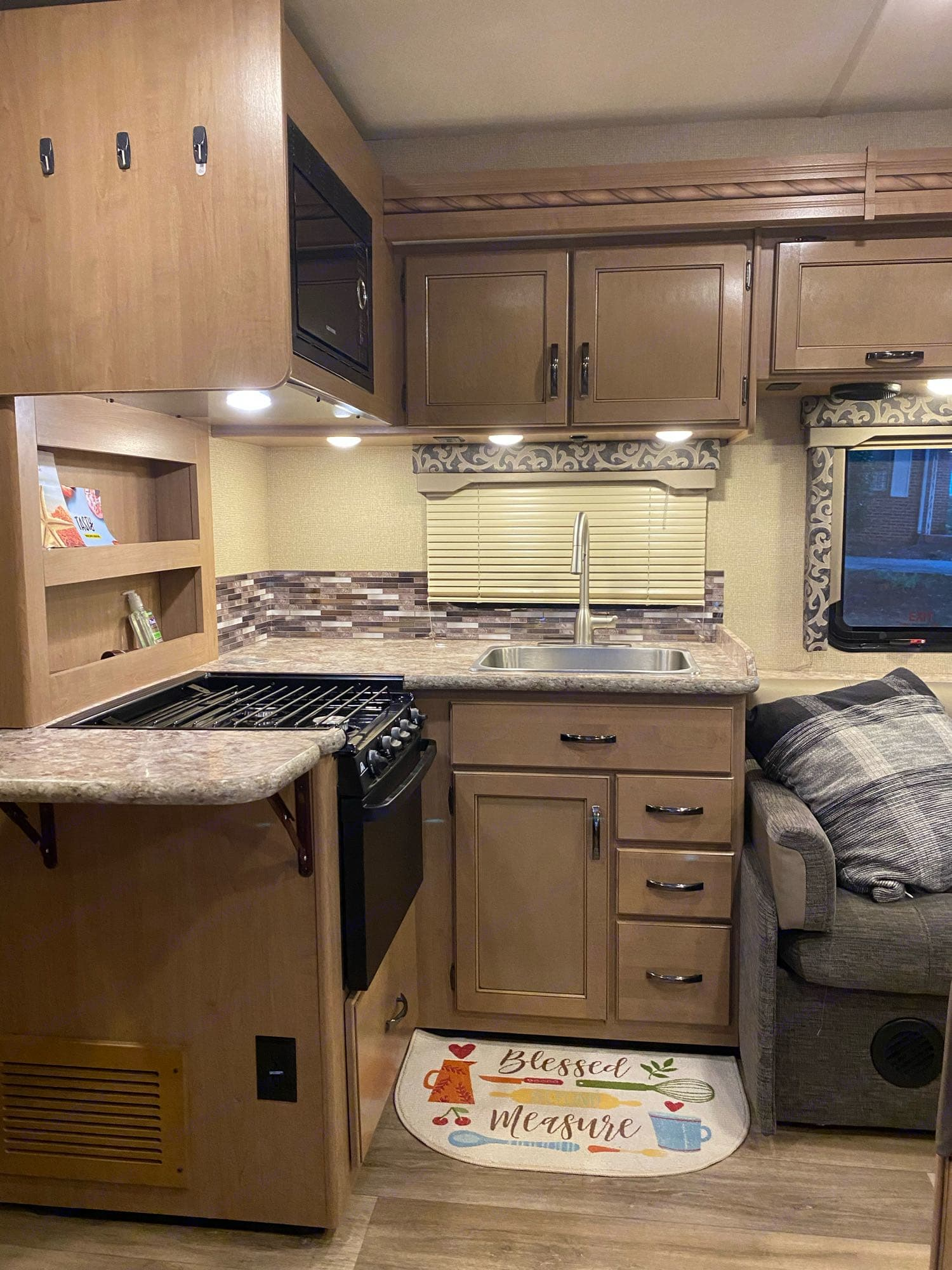Full kitchen with toaster and microwave.. Thor Motor Coach Four Winds 2018
