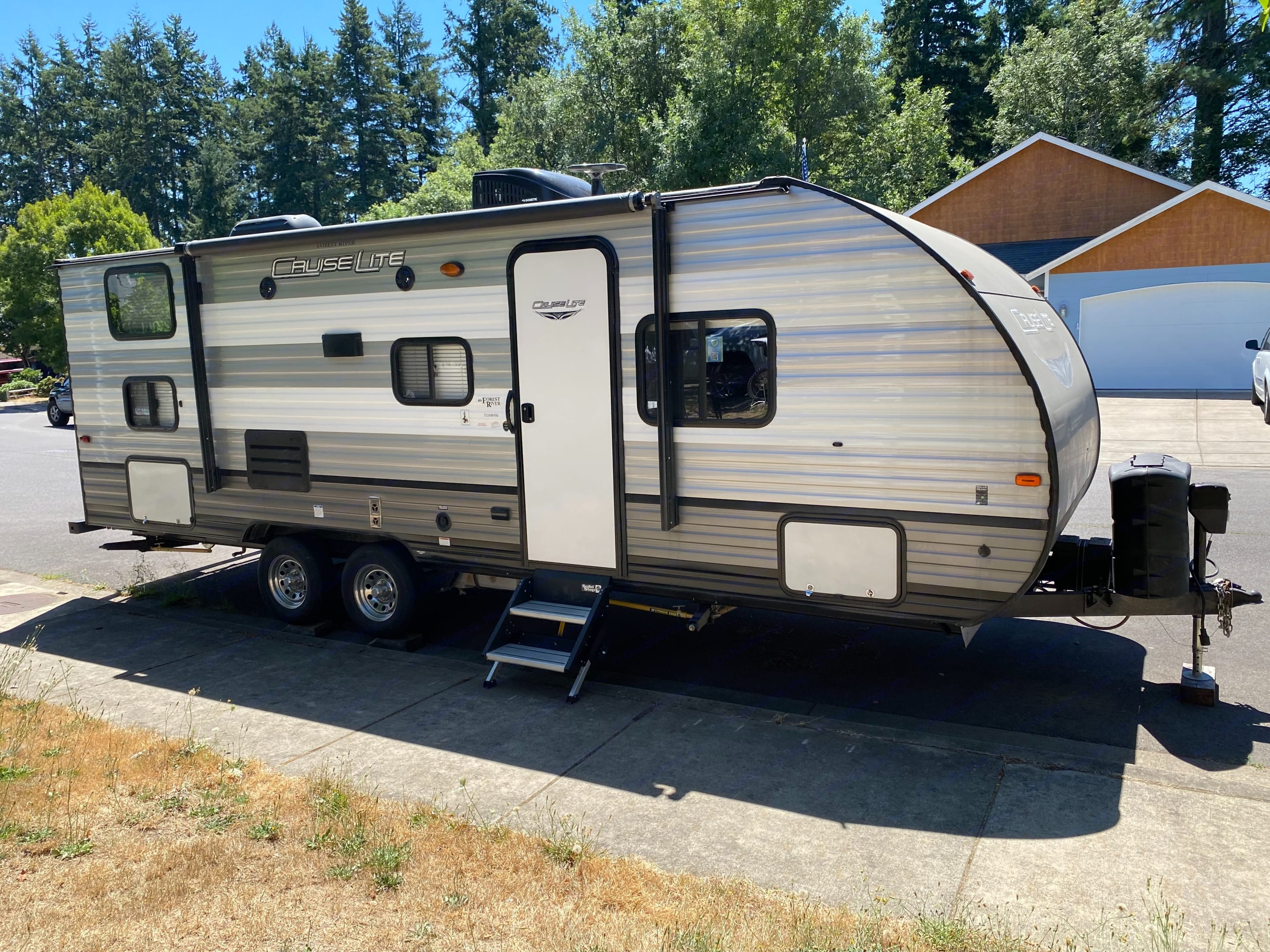 Exterior of the trailer with steps and awning. Speakers outside as well as lights. Forest River Cruise Lite 2019