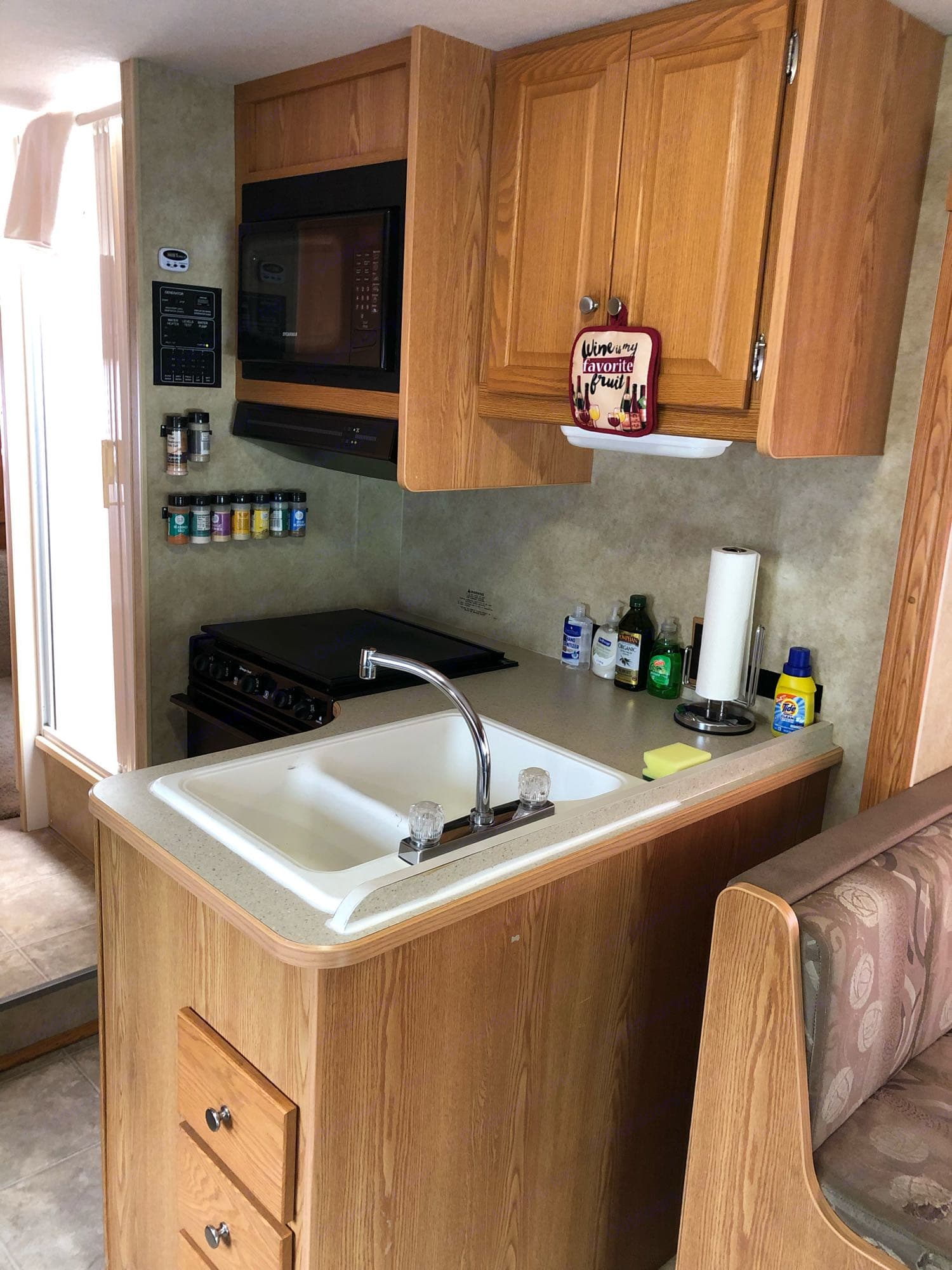 Kitchen is well equipped with everything you need! Microwave, gas oven, stove, with hood and sink. And, of course, a coffee maker!. Winnebago Access 2008