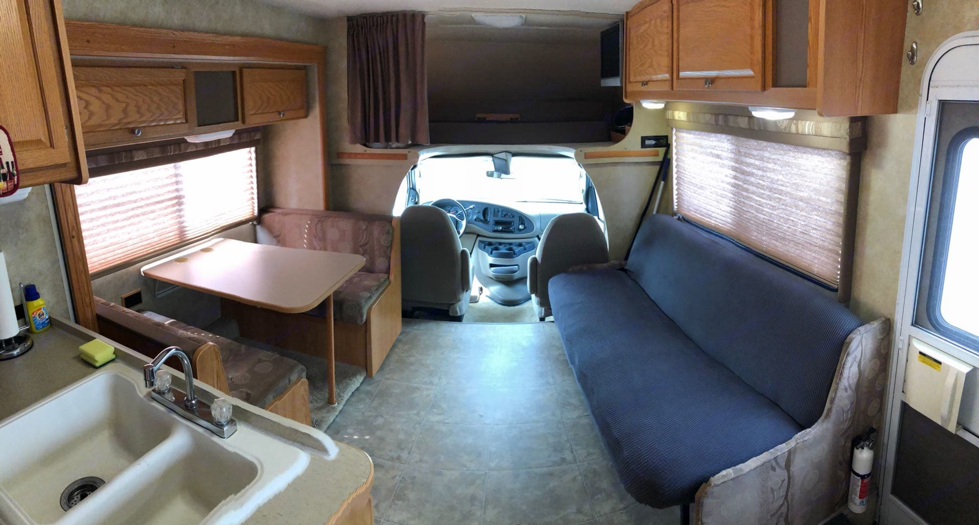 Loft with ladder, privacy curtain and queen size bed. Couch folds out into full size bed. Dinette table folds down and becomes a 4th bed when needed!. Winnebago Access 2008
