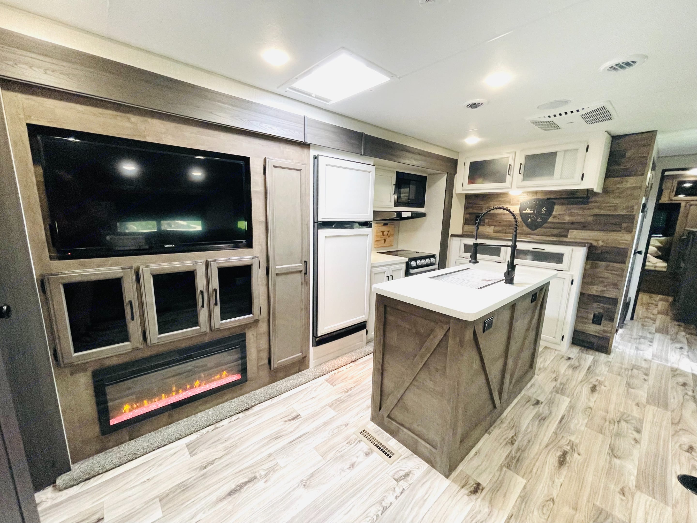 Kitchen features pantry, island, coffee bar + more.. Venture Rv Sporttrek 2021