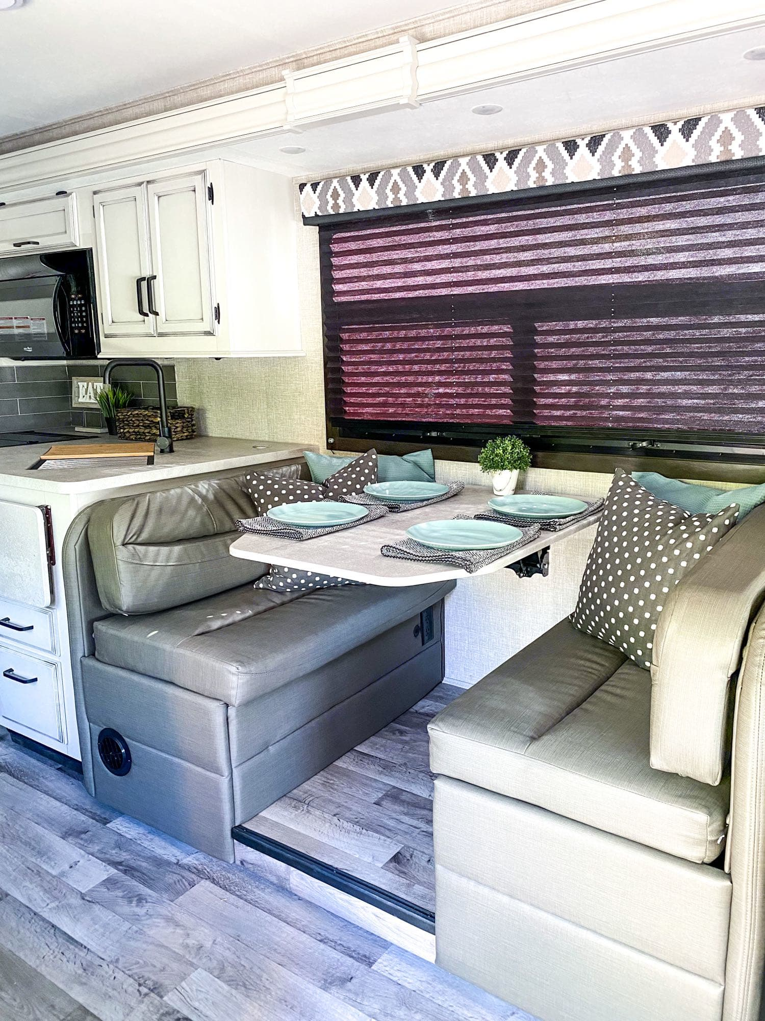 Dining table with 2 cup holders and 4 seatbelts.. Entegra Coach Other 2022