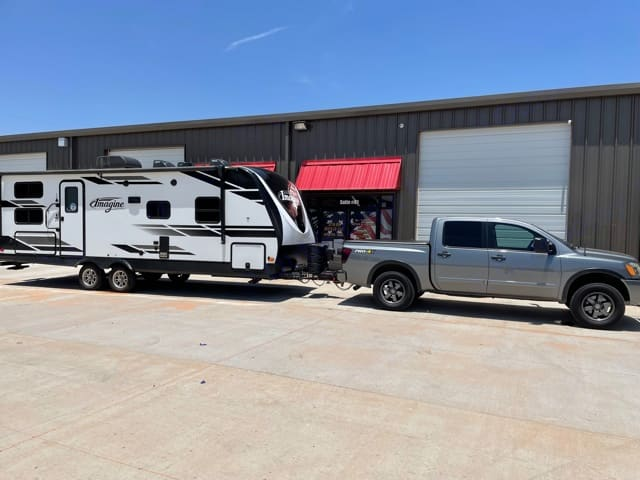 """GVWR: 7,495 lbs.   Hitch Weight: 800-1,100 lbs depending on cargo.  800 lbs includes batteries and propane tanks.  Length: 28' 11"""". Grand Design Imagine 2400BH 2020"""