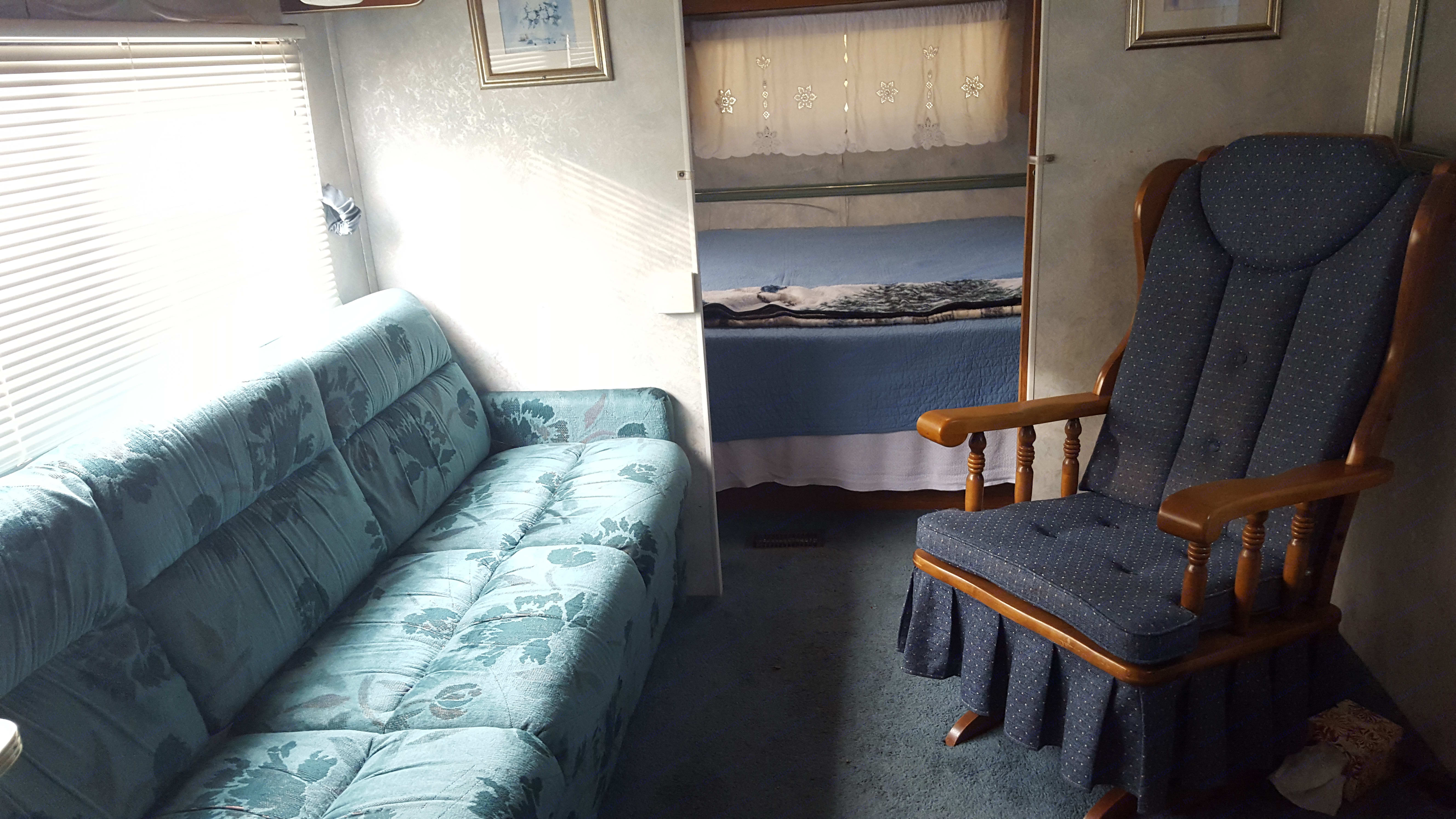 Couch, rocking chair, bedroom with sliding doors.. Coachmen Catalina 1994