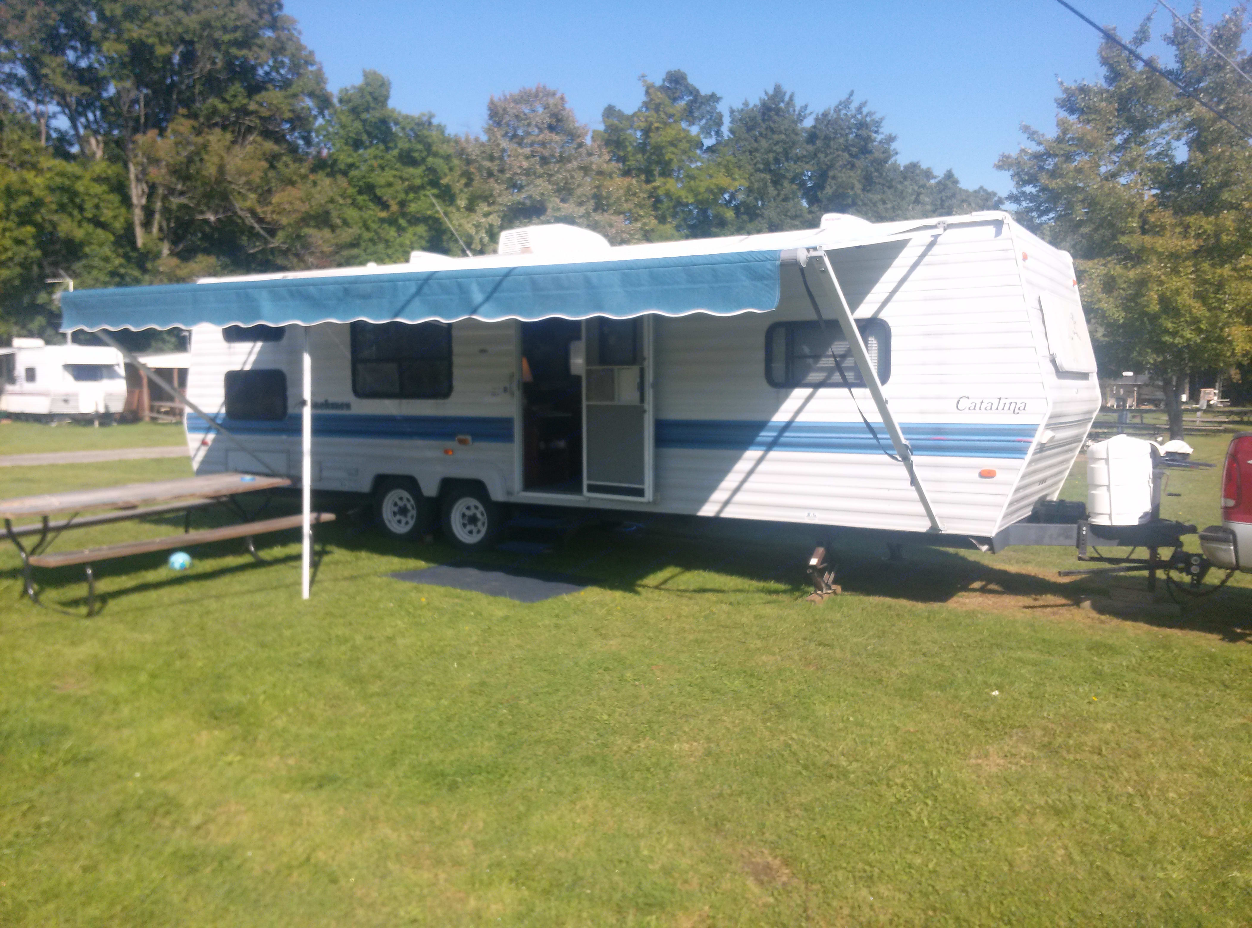 29 foot long camper.  (33 ft from tongue to tail).  Long newer awning gives lots of shade.. Coachmen Catalina 1994