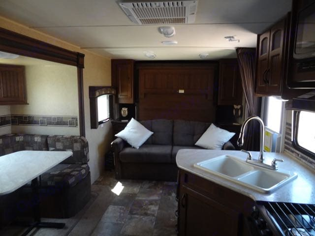 Murphy bed hides out of the way so you can use the sofa.. Jayco White Hawk 2014