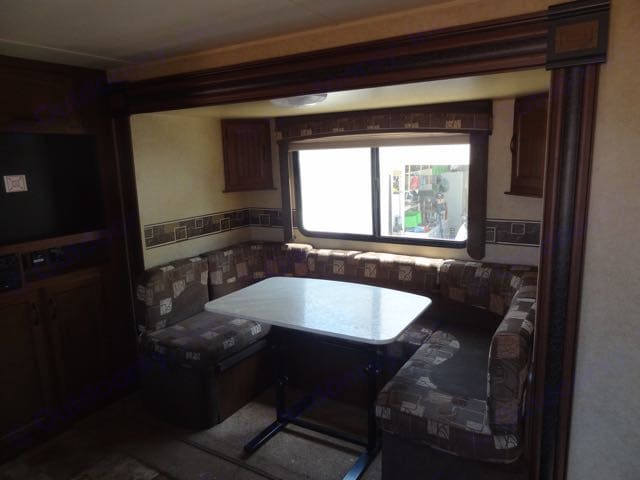 Dinette converts to another sleeping area for one or two people.. Jayco White Hawk 2014