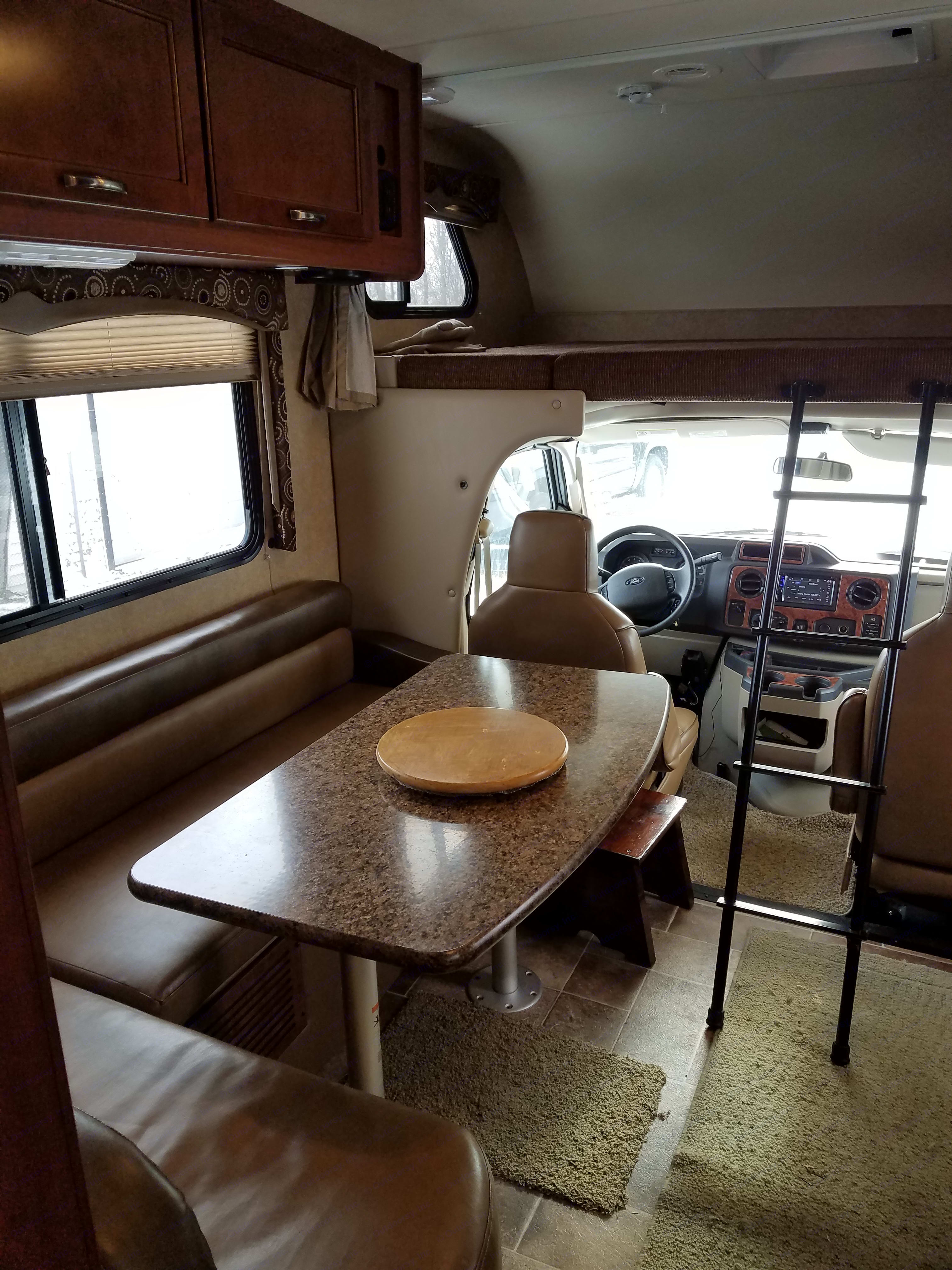Dining area, bunk, storage over dining area.. Thor Motor Coach Four Winds F28 2016