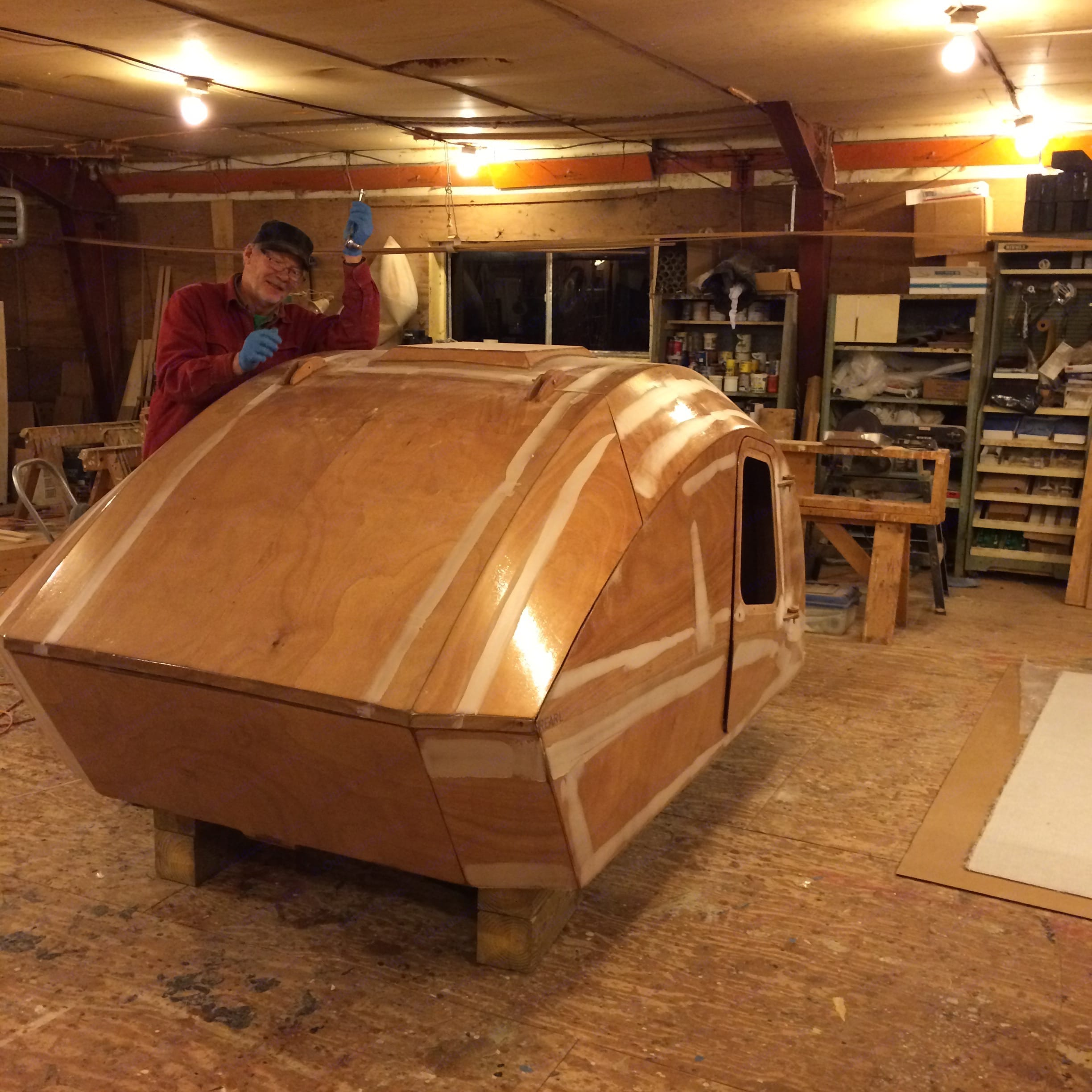 Bright plywood shell after the application of fibreglass cloth.. Chesapeake Light Craft Teardrop Trailer 2015