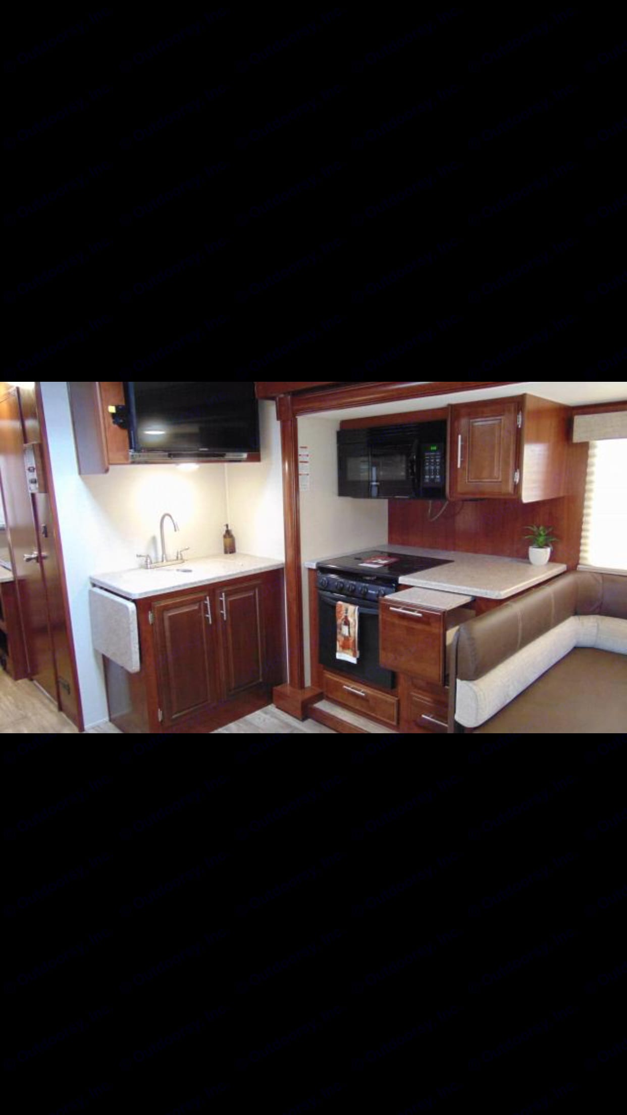 Kitchen with full size microwave, cooktop and oven. Forest River Fr3 2016
