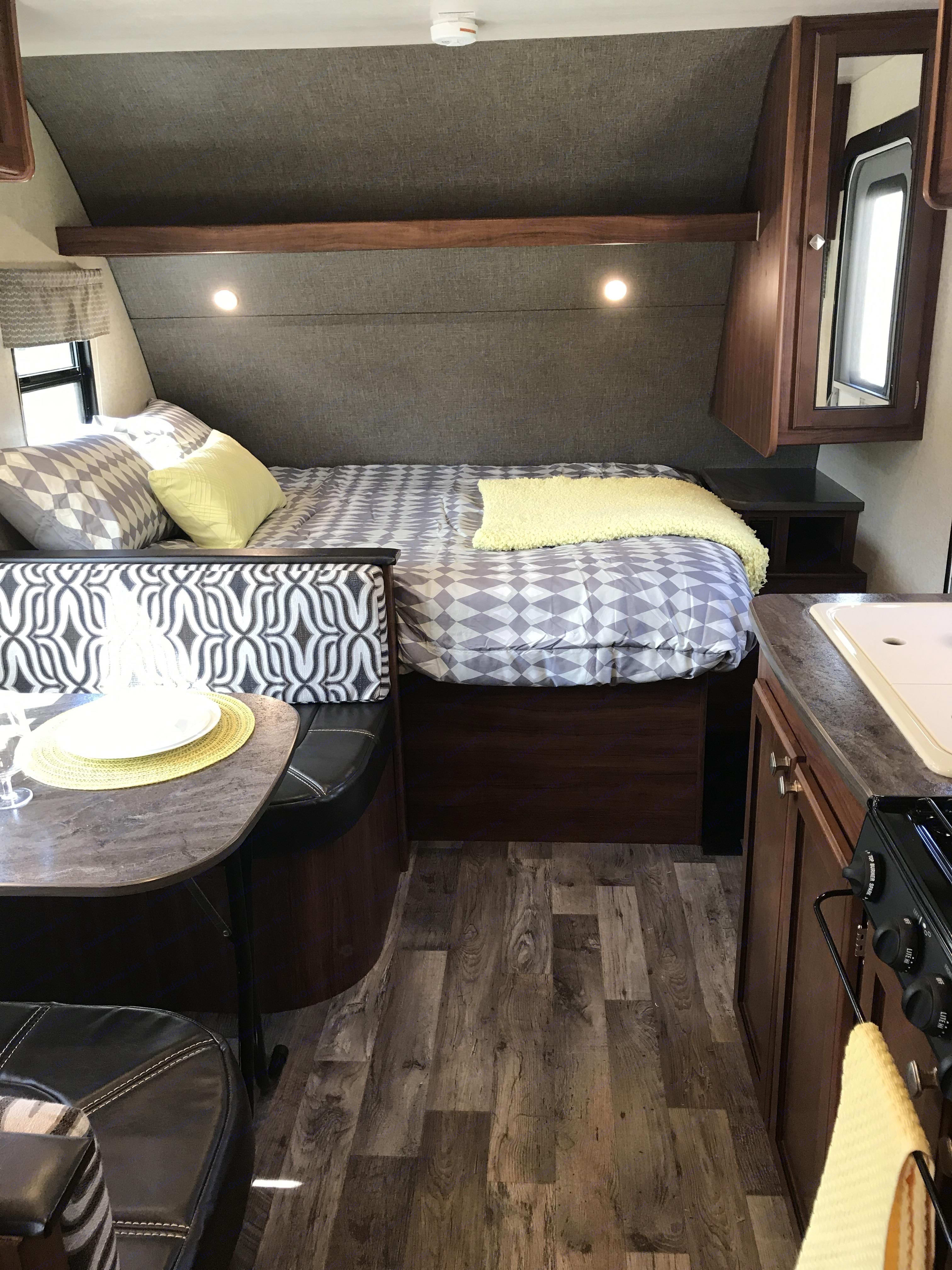 Queen bed in front with side wardrobe. Heartland Mallard 2018