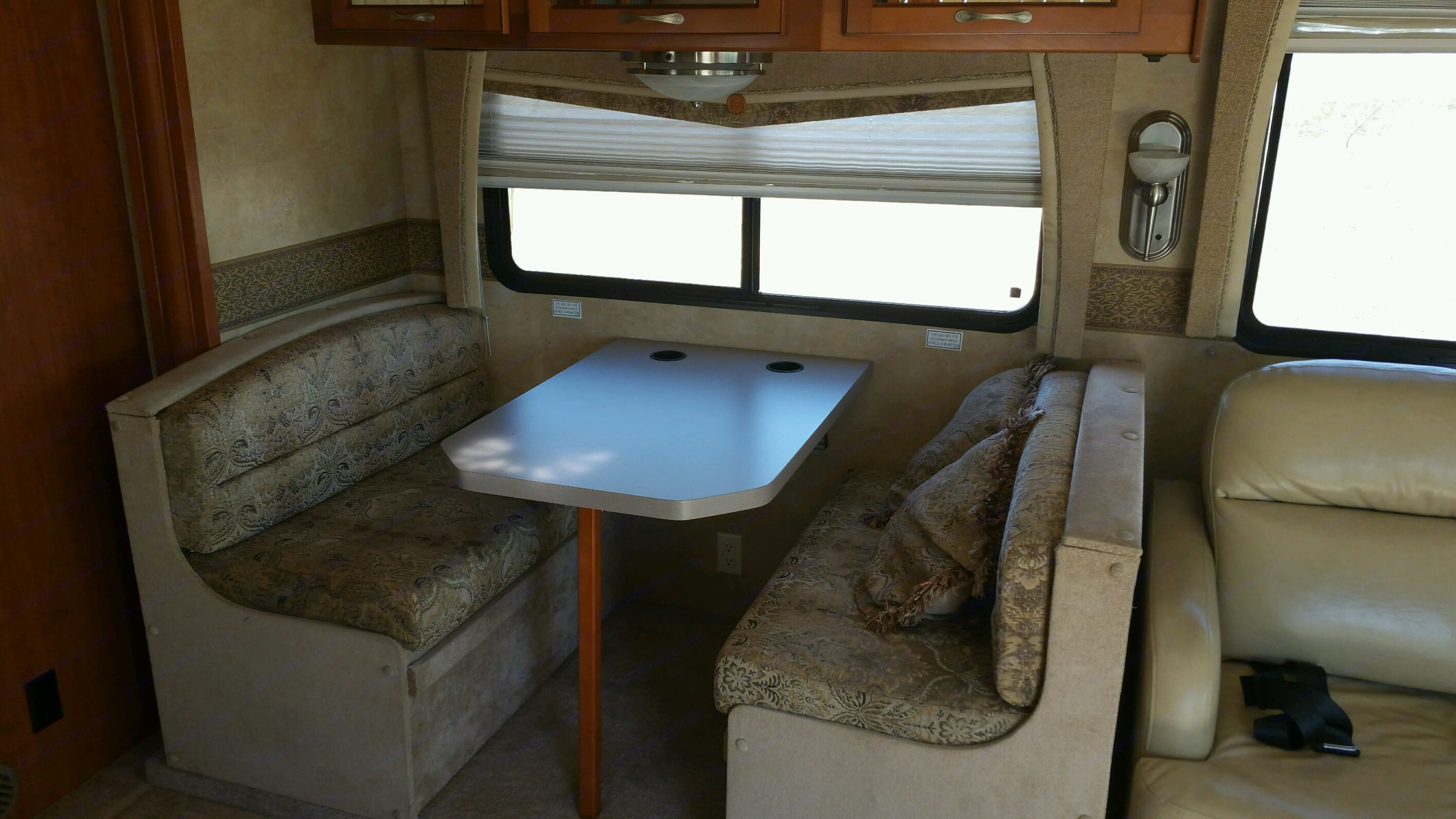 Dinning table that doubles as a sleeping space. Forest River Georgetown 2009