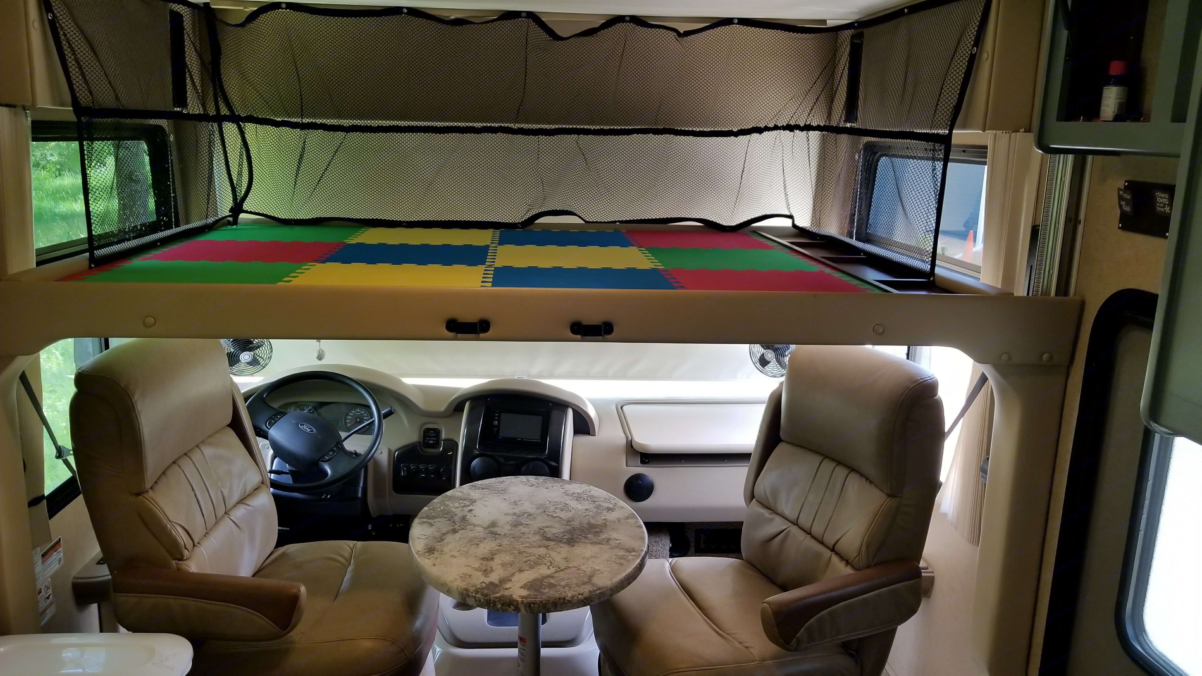When the front bunk is down, it provides a sleeping platform for a full sized air mattress. Thor Motor Coach Miramar 2015