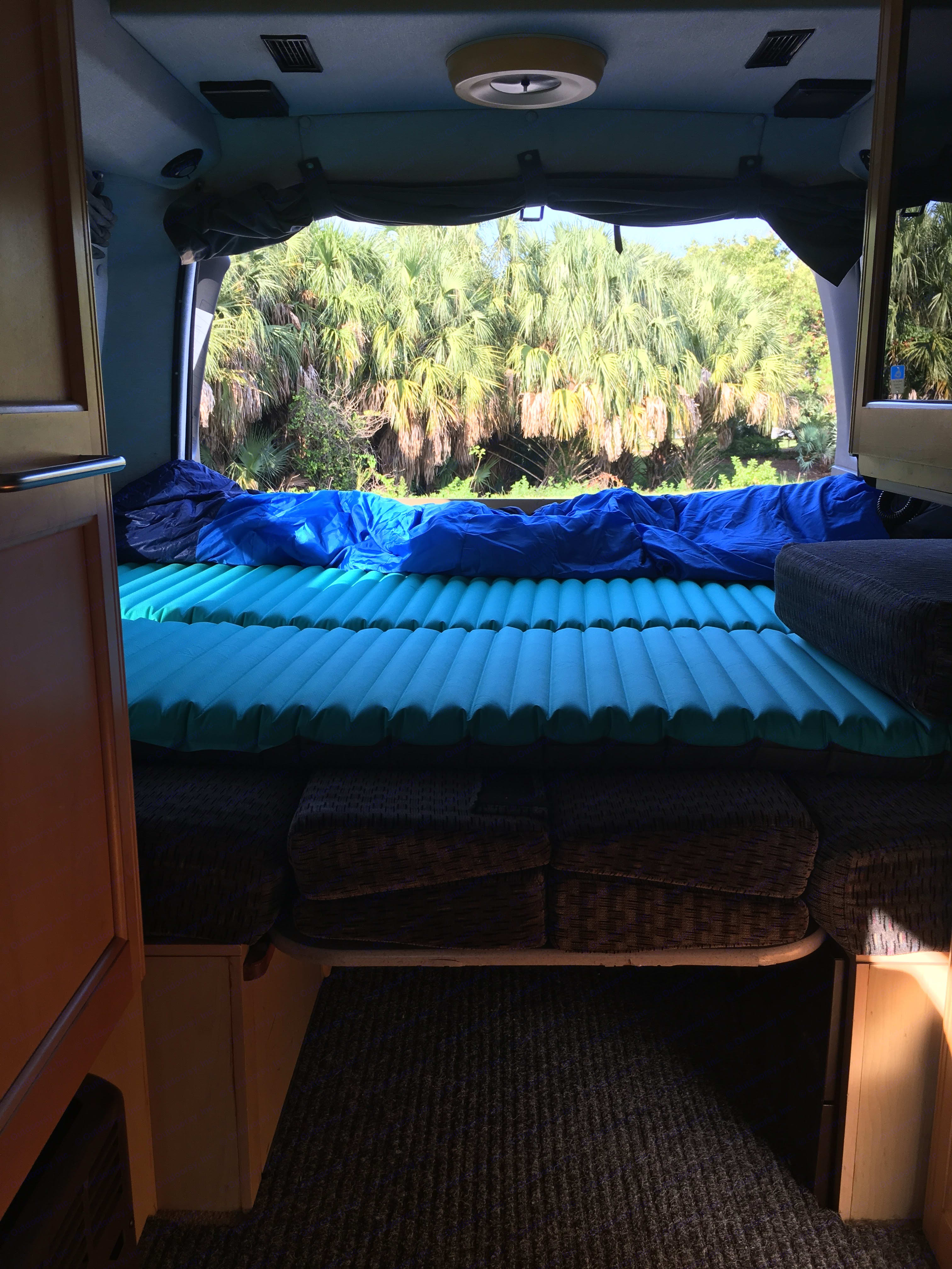 Rear bed has recently been redone with actual padding. Inflatable mattresses available inside for additional comfort if needed.. Roadtrek 190 Versatile 2004