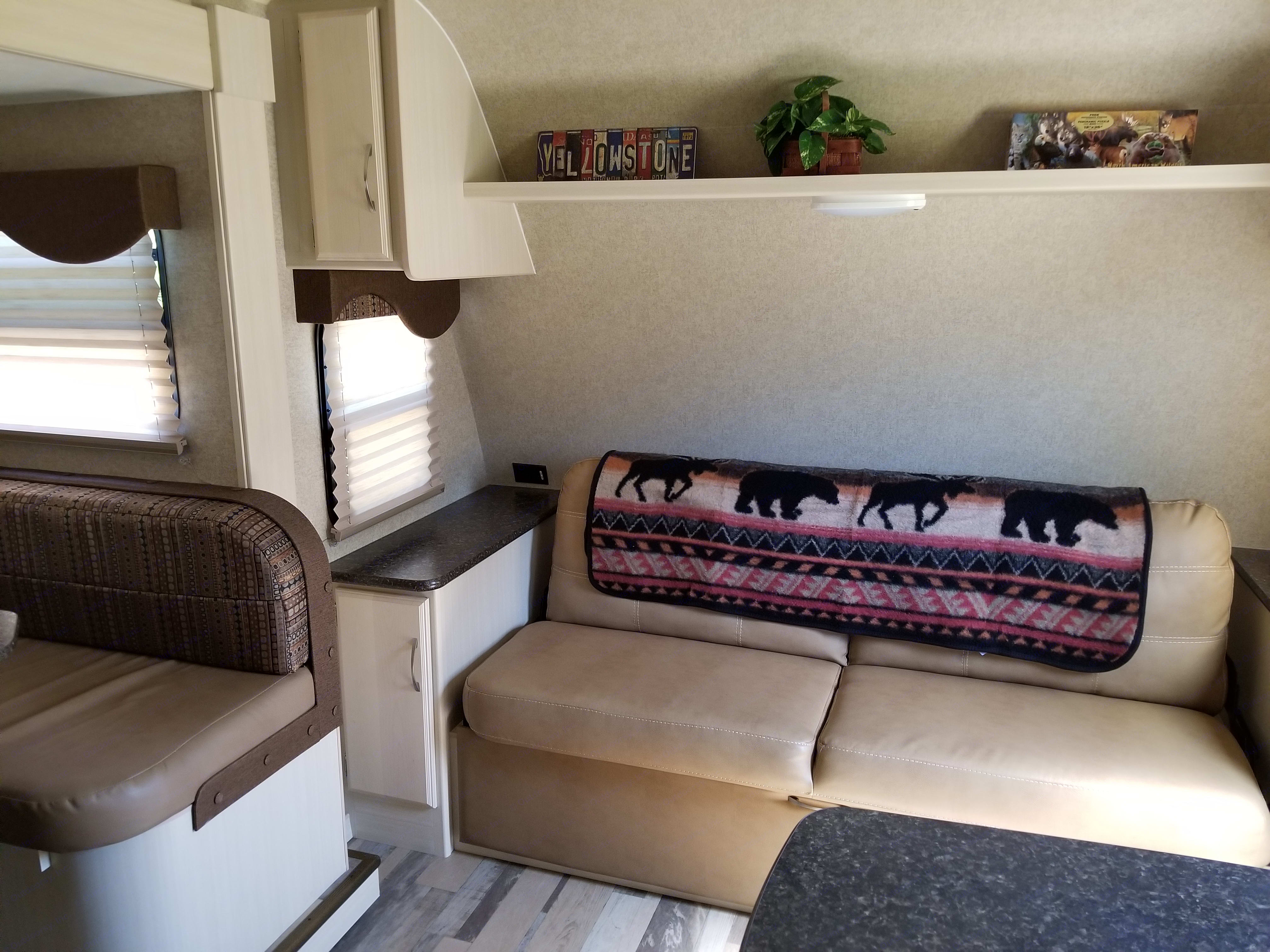 Couch is comfy for TV watching, plus provides extra storage and a bed.. Winnebago Minnie 2017