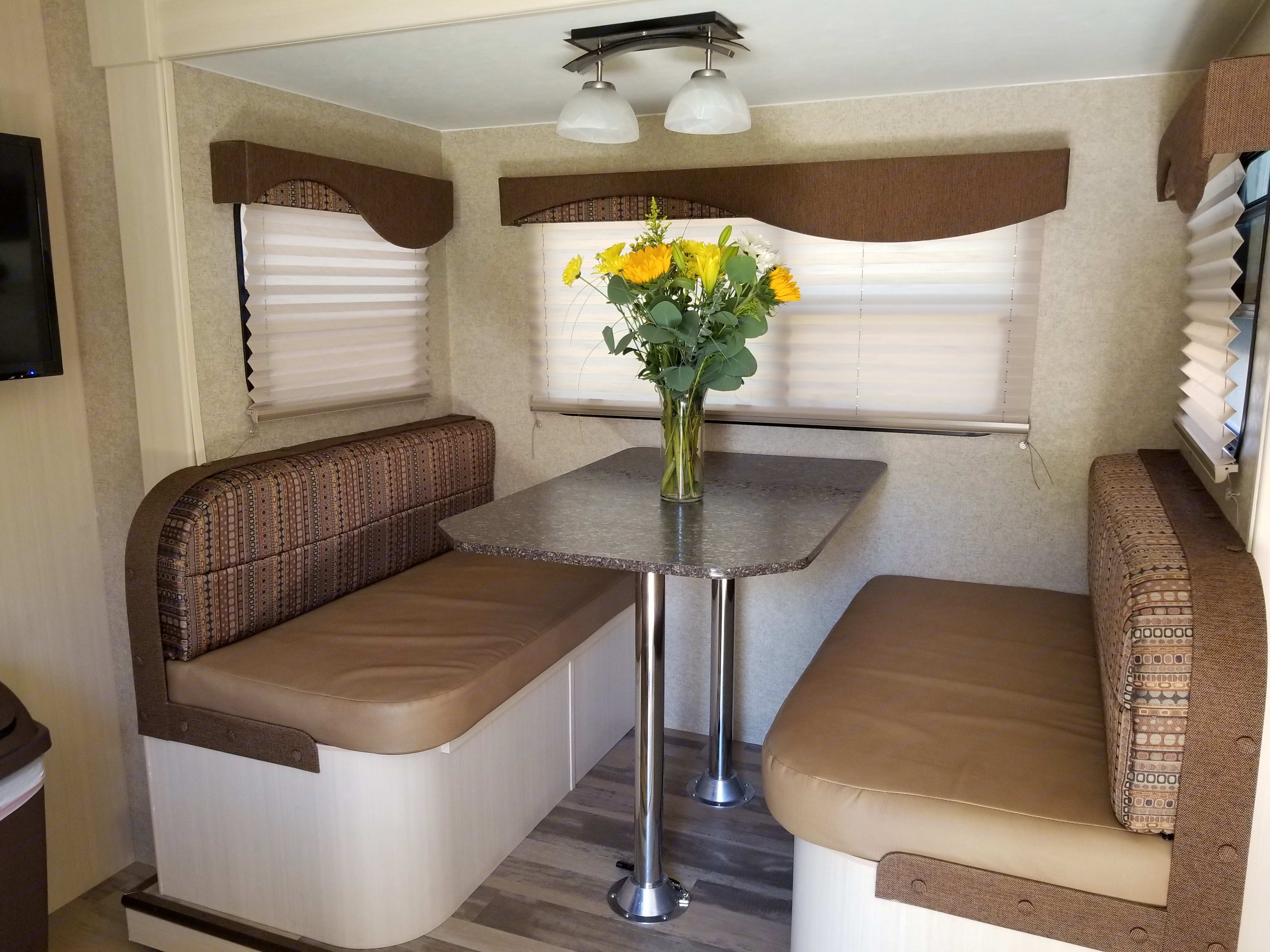 Dinette offers storage space plus an extra bed.. Winnebago Minnie 2017