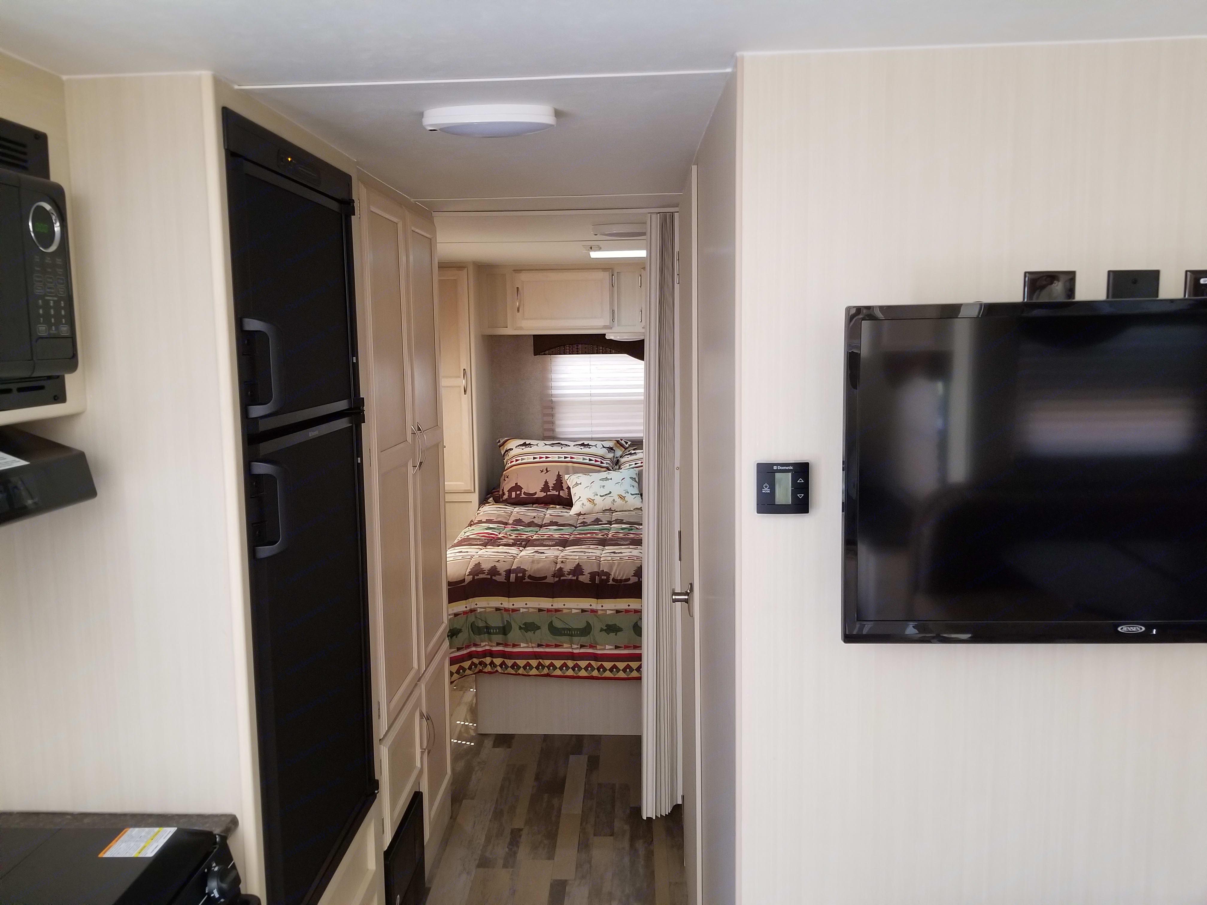 Refrigerator, pantry, storage and flat screen TV.. Winnebago Minnie 2017