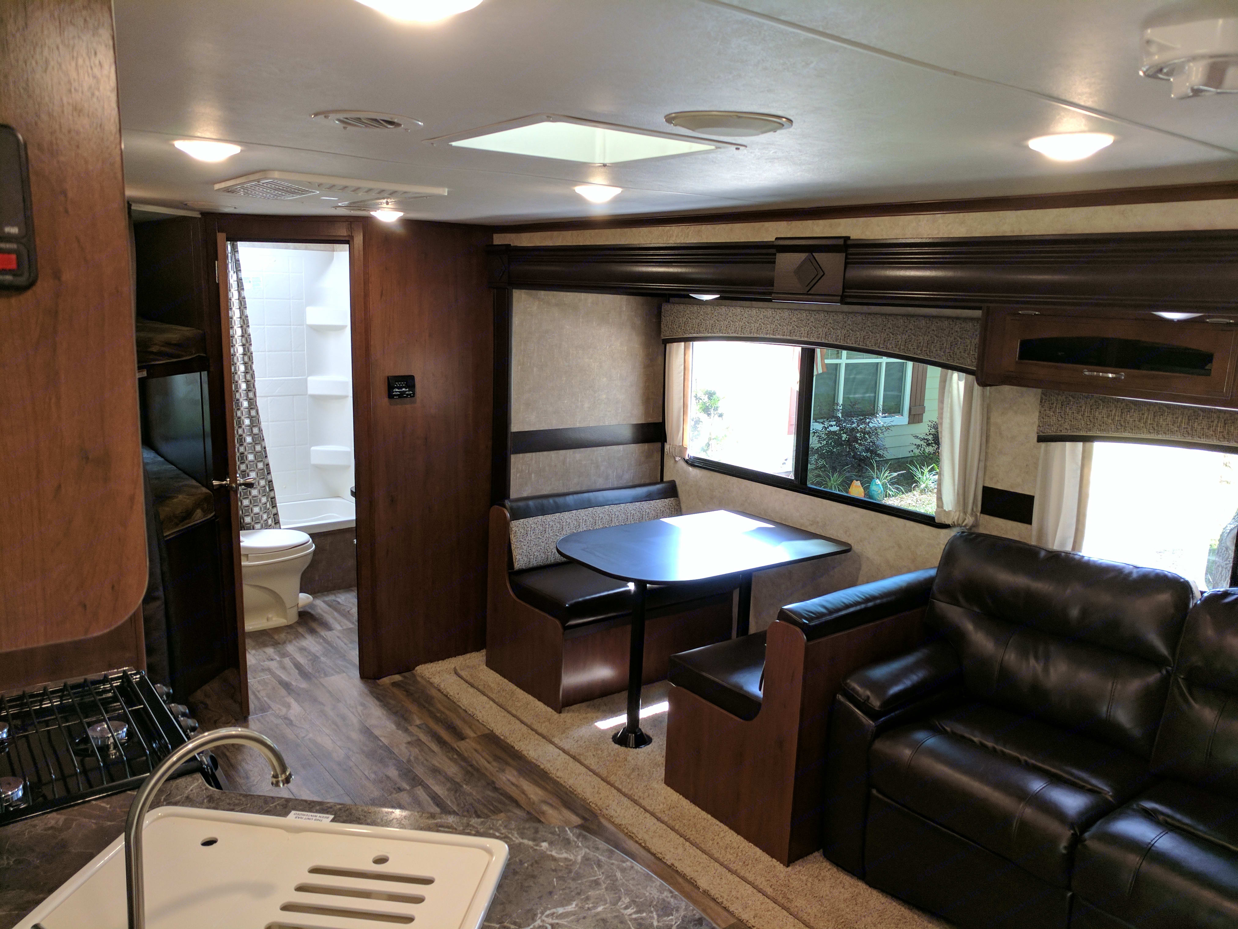 Table and couch area on the slide-out, both can be beds.. Jayco Jay Feather 2017