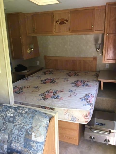 Master bedroom with storage underneath bed and in cabinets. Closing accordian door.. Crossroads Zinger 2006