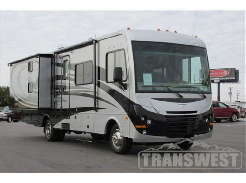Outside view of the coach with rear slide open.. Fleetwood Terra 2014
