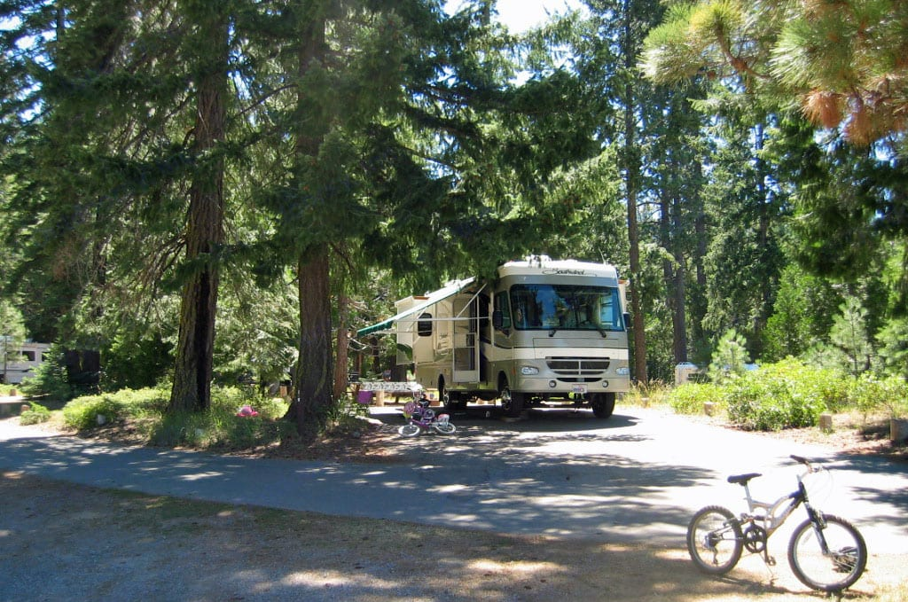 Family dry camping at beautiful Fowlers Campground in majestic McCloud CA.. Fleetwood Southwind 2003