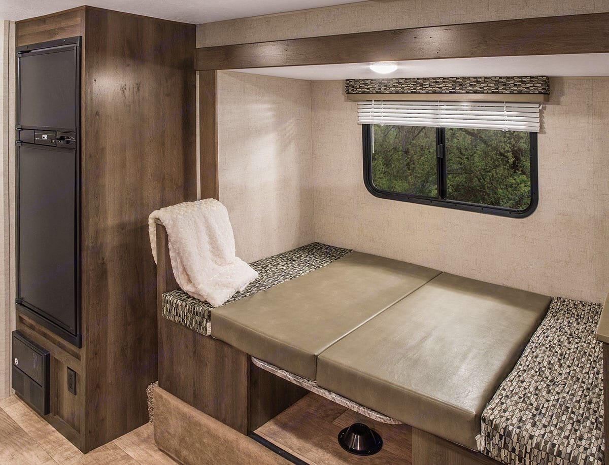 dinning area that's been converted to bed. K-ZManufacturing Escape 2018