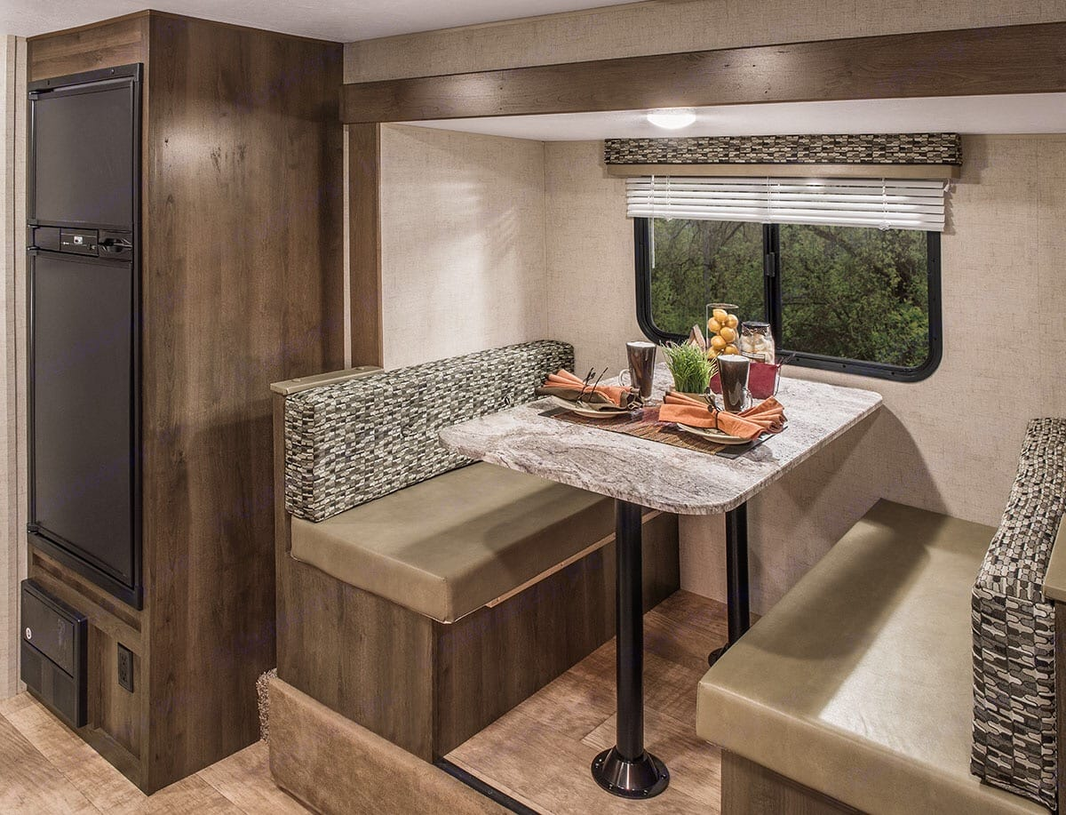 slide out dinning area that also double as a bed. K-ZManufacturing Escape 2018